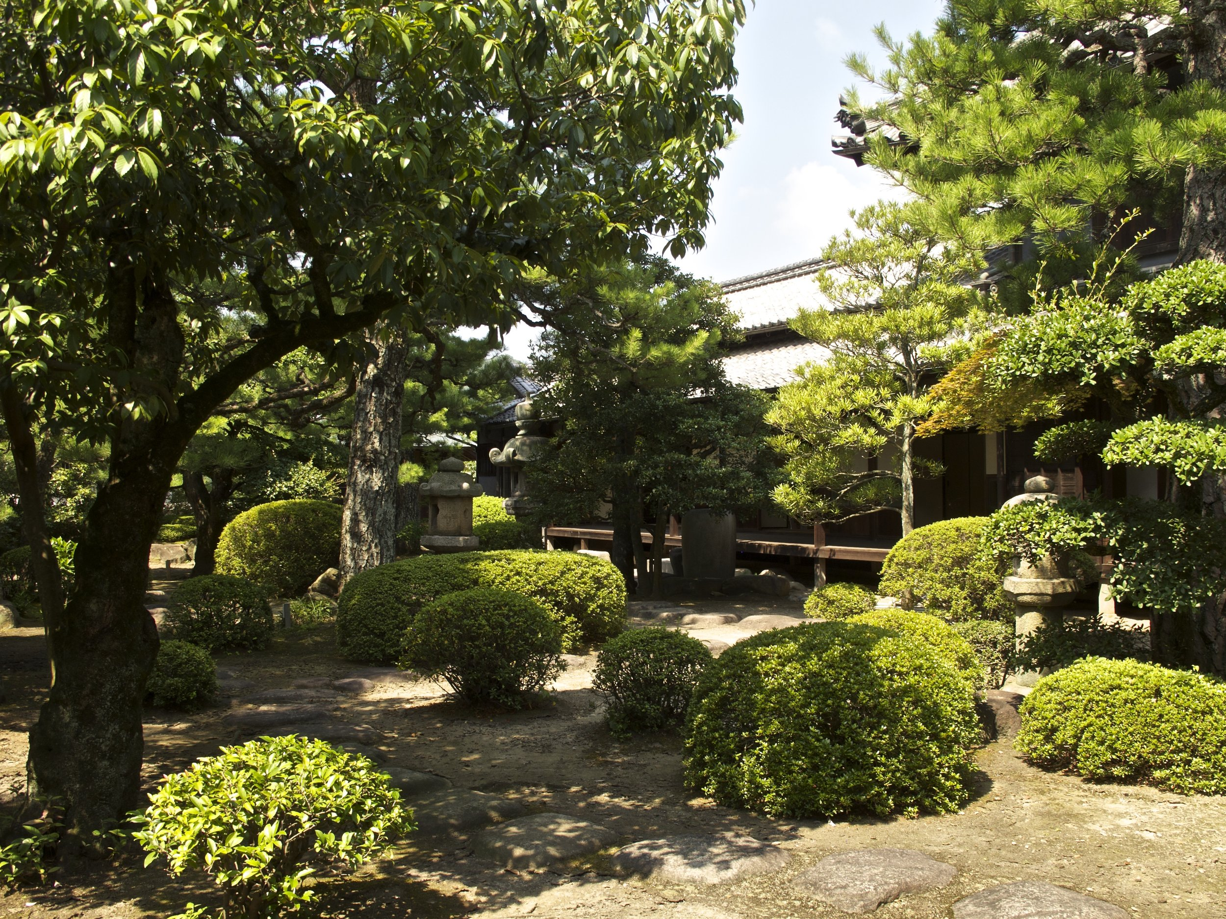 """The courtyard garden is filled with artifacts from Edo-era gardens including the beautiful """"Fuji-an"""" teahouse in a corner of the garden."""