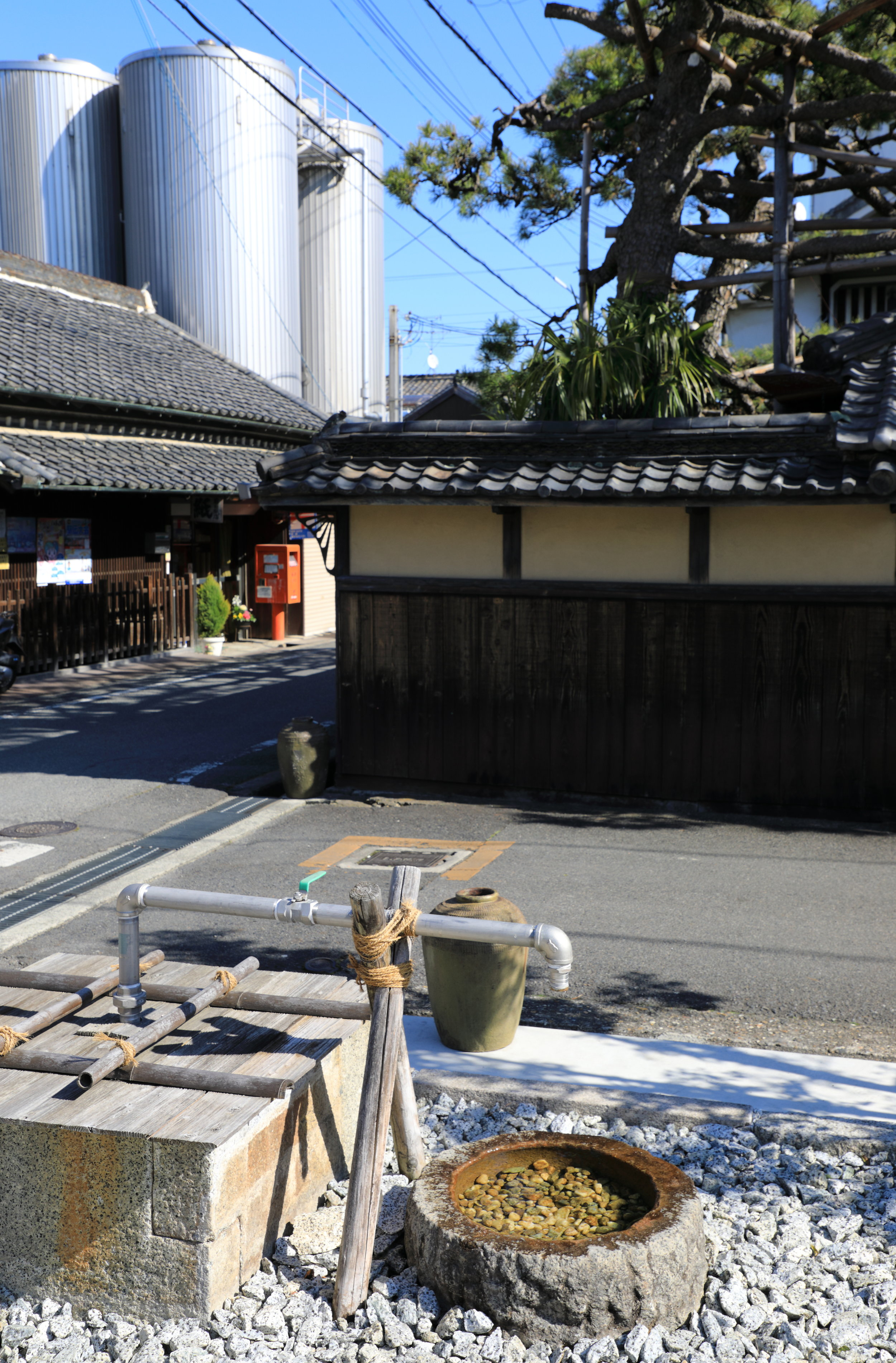 The original 1700s building at Yucho Shuzo sake brewery, well, and steel tanks reflect the key elements behind Kaze no Mori sake's success: Centuries of sake-brewing know-how, the best local ingredients, and modern technology. Yoshi is proud of the pristine and delicious spring water used for  Kaze no Mori  sake and makes it available to anyone in the community who wants to fill a container.