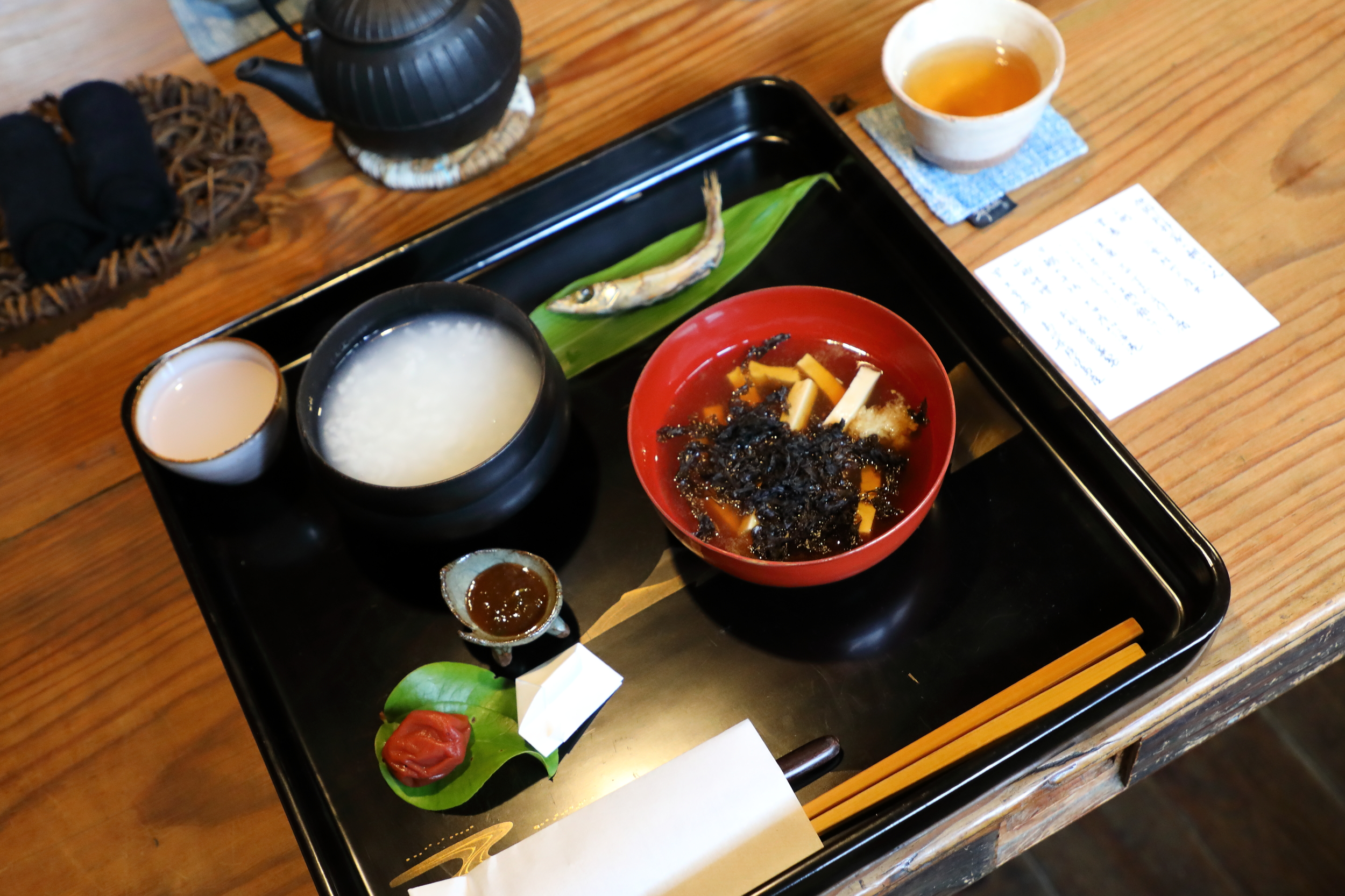 Breakfast in spring at Takyo Abeke includes  okayu  rice porridge, grilled river fish, and a local specialty of hardened tofu that is cut into strips and served like noodles in a thick and savory dashi soup.