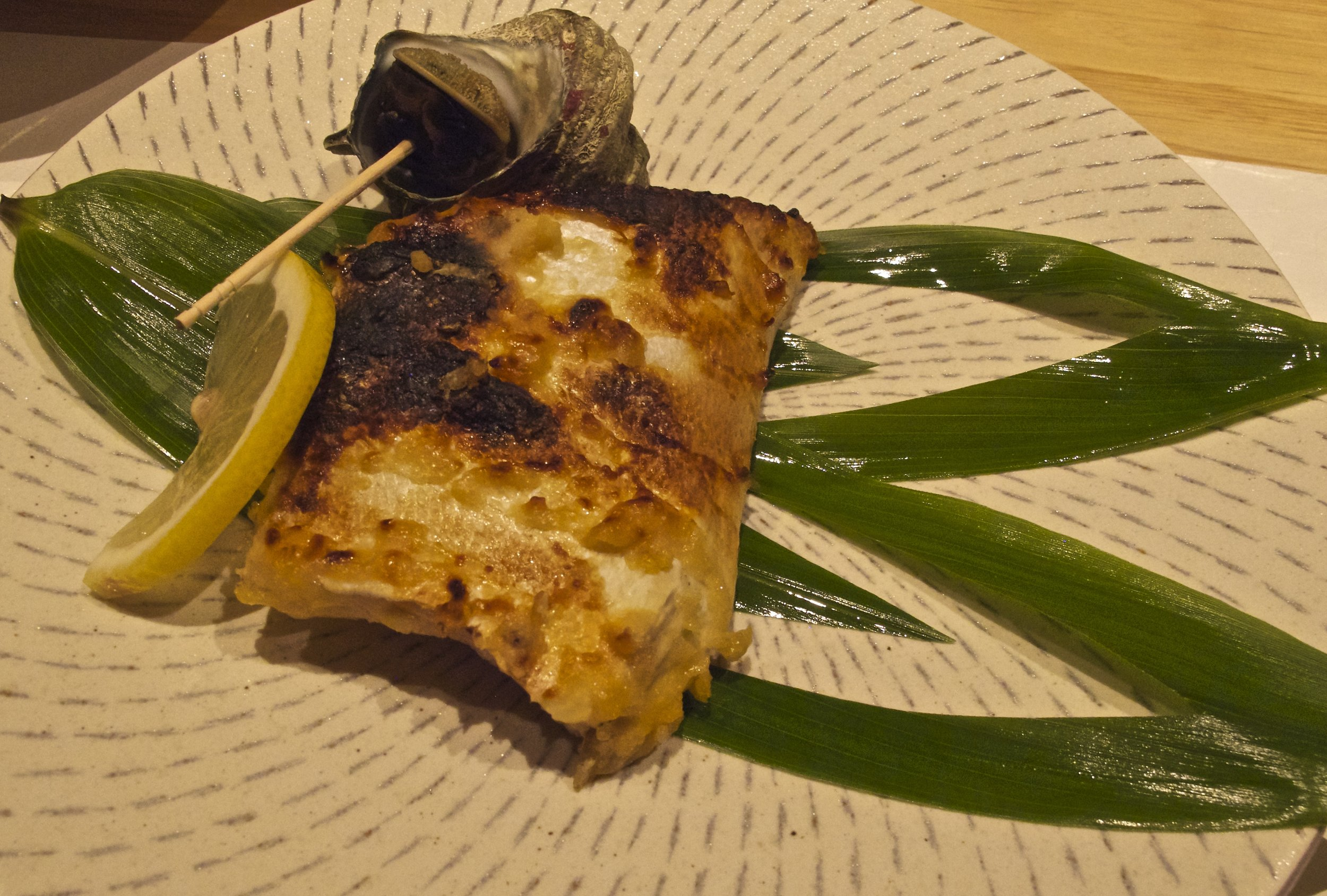 Being leaner late in the season at the end of spring,  Sawara , or Spanish mackerel, has been marinaded in miso and broiled to enrich its flavor.