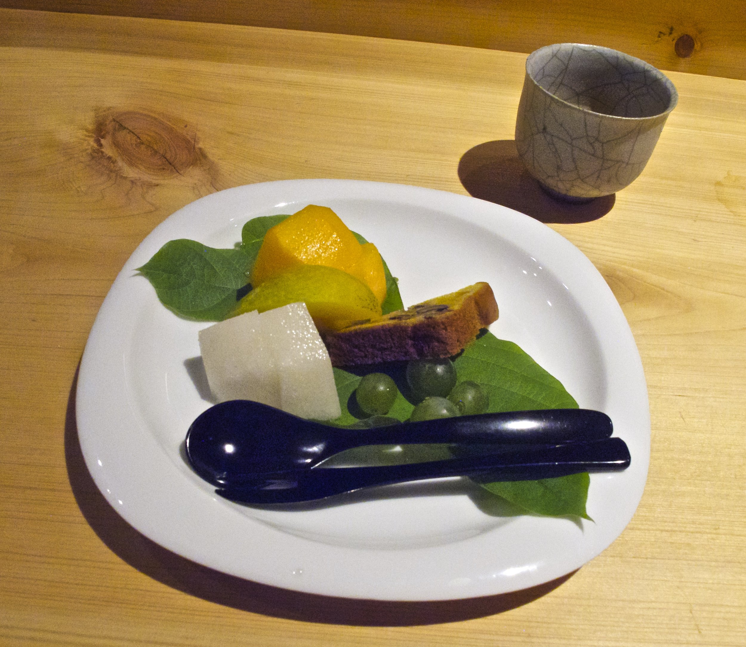 Mizumono (水物) - Dessert is a piece of nut cake accompanied by several sweet and juicy seasonal fruit with a range of textures, including lush persimmon, crisp Kyo-tango pear from the Tango Peninsula north of Kyoto, soft, grainy nikkori-nashi pear, and bright tiny Niagara grapes.