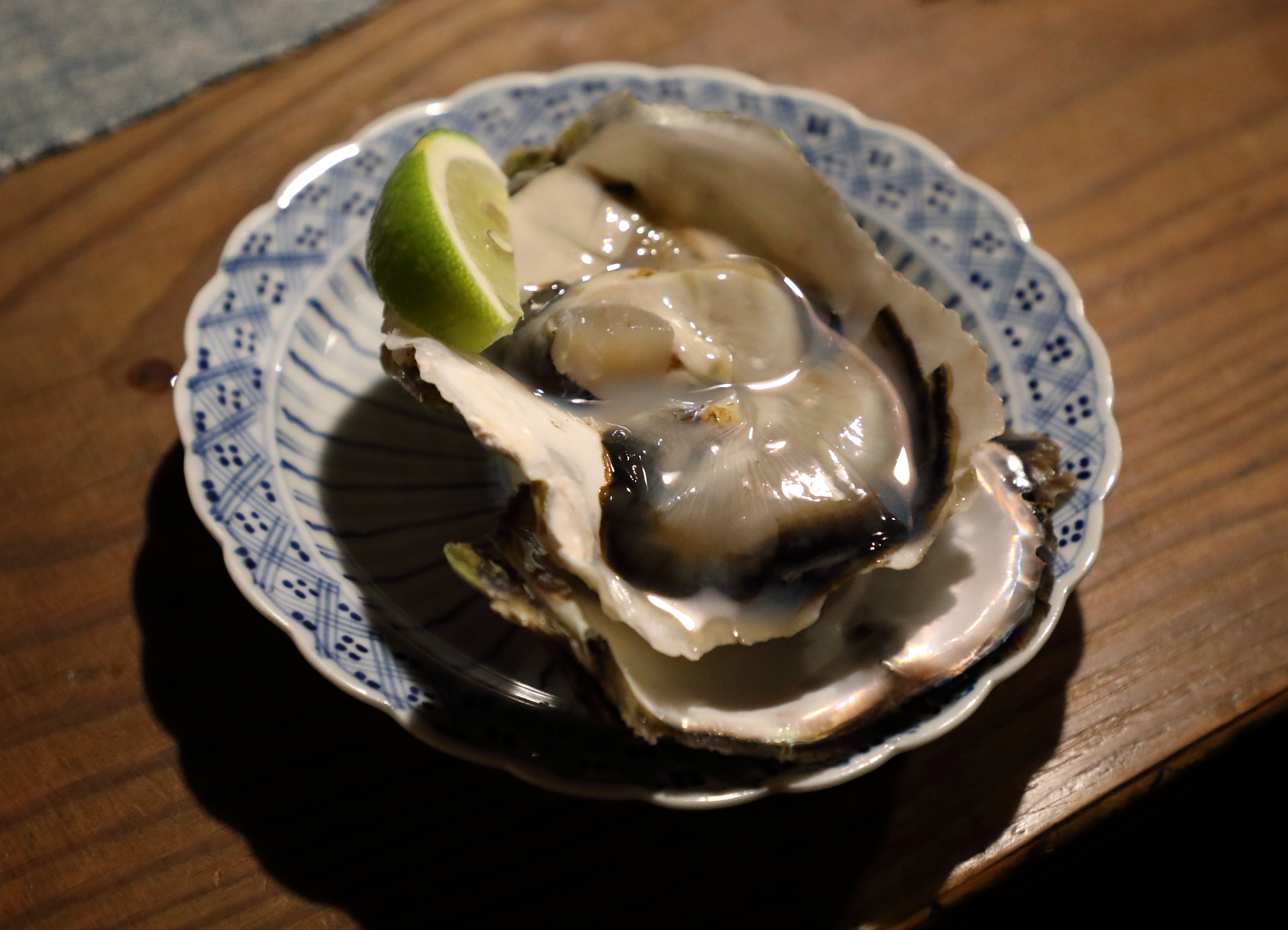 The color, fragrance, and mild acidity of  ao-lemon , or green lemon, is a perfect match for the rich yet delicate flavor of Japan's summer  iwagaki  rock oysters