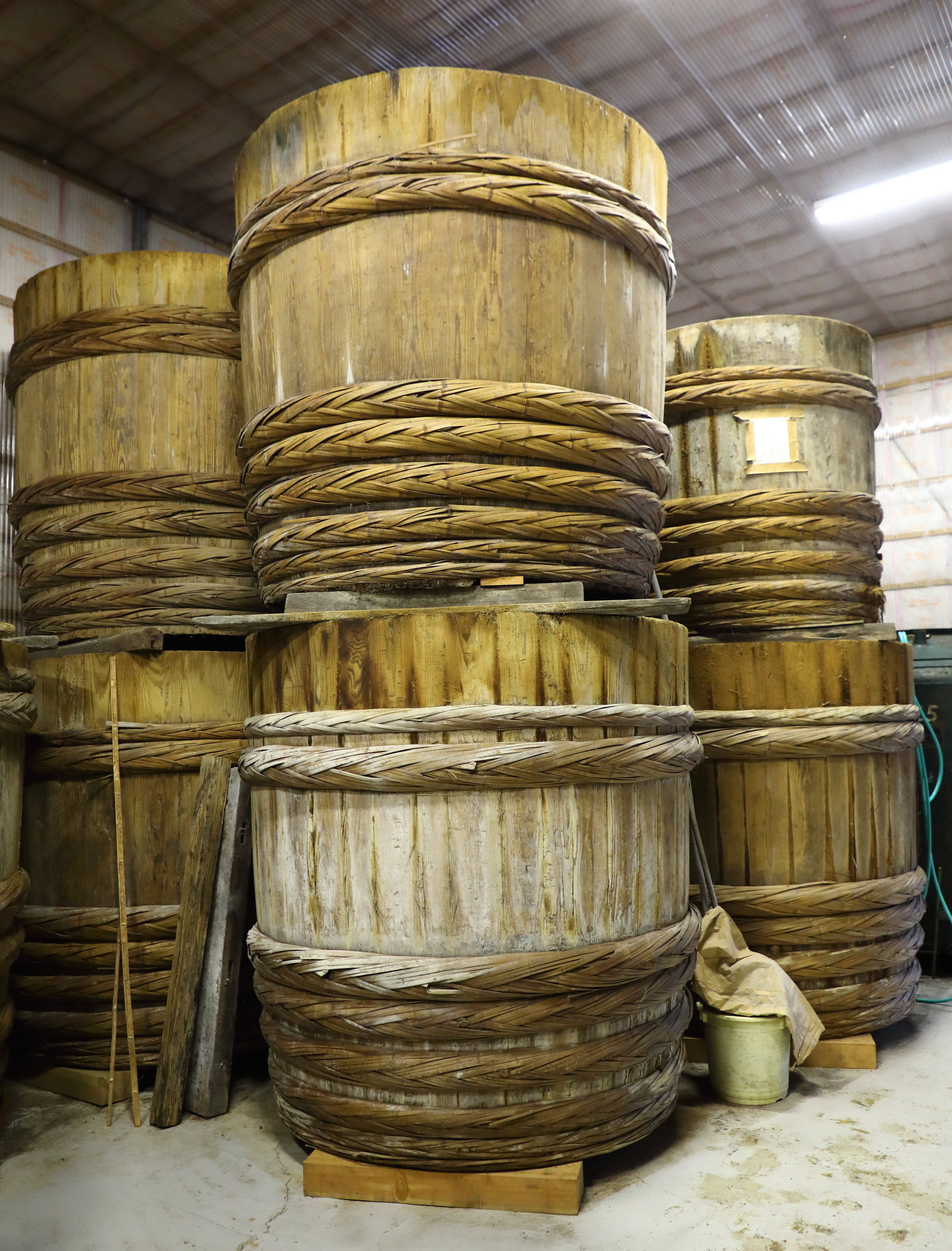 The wooden barrels in which Tanakaya ferments its soy sauce can be used for up to 200 years.