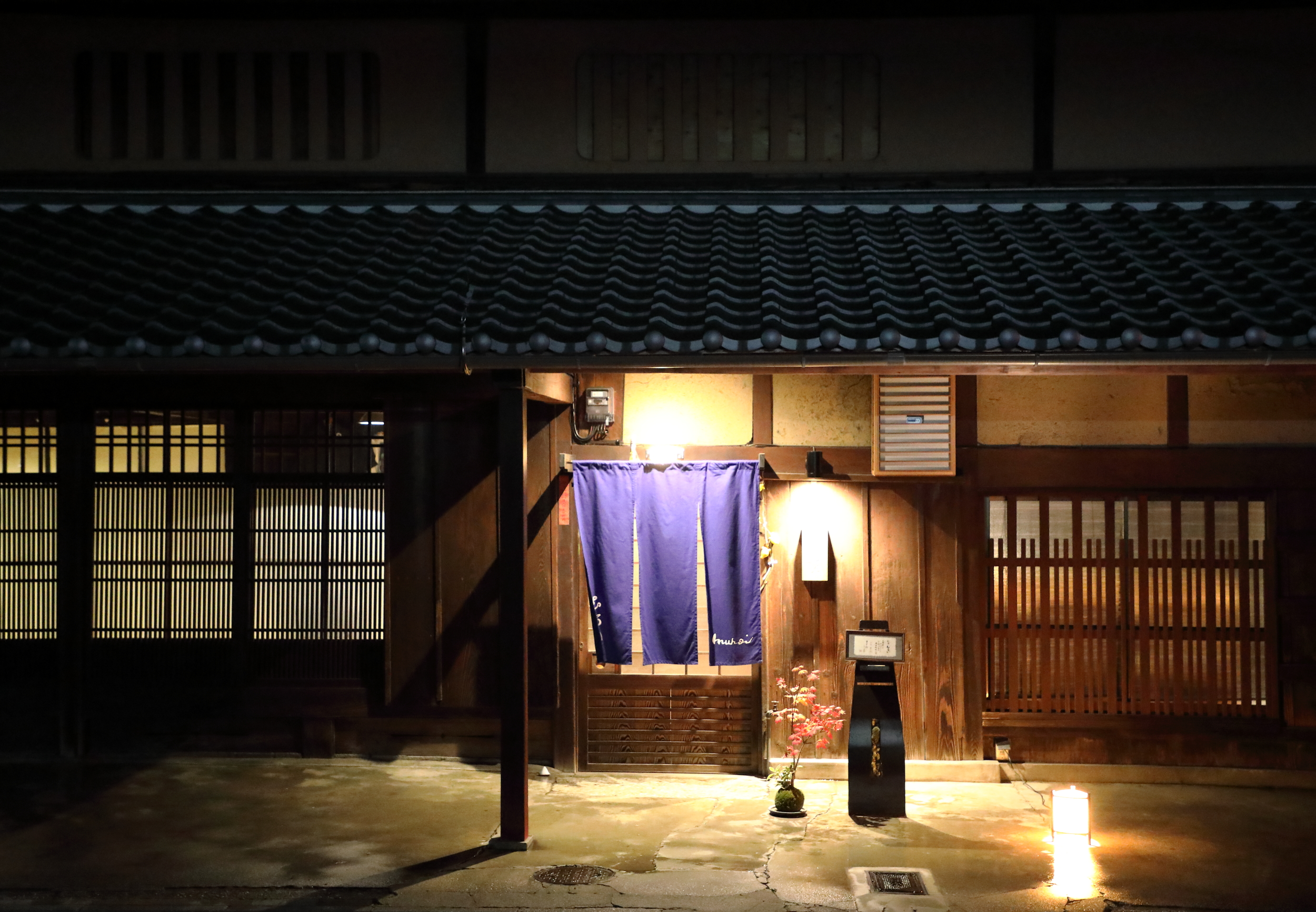 The earthy colors of the old  kominka , or farmhouse, that houses Muroi are typical of rural architecture in the mountainous areas of Kyoto prefecture.Muroi ready to receive guests for dinner in the evening.