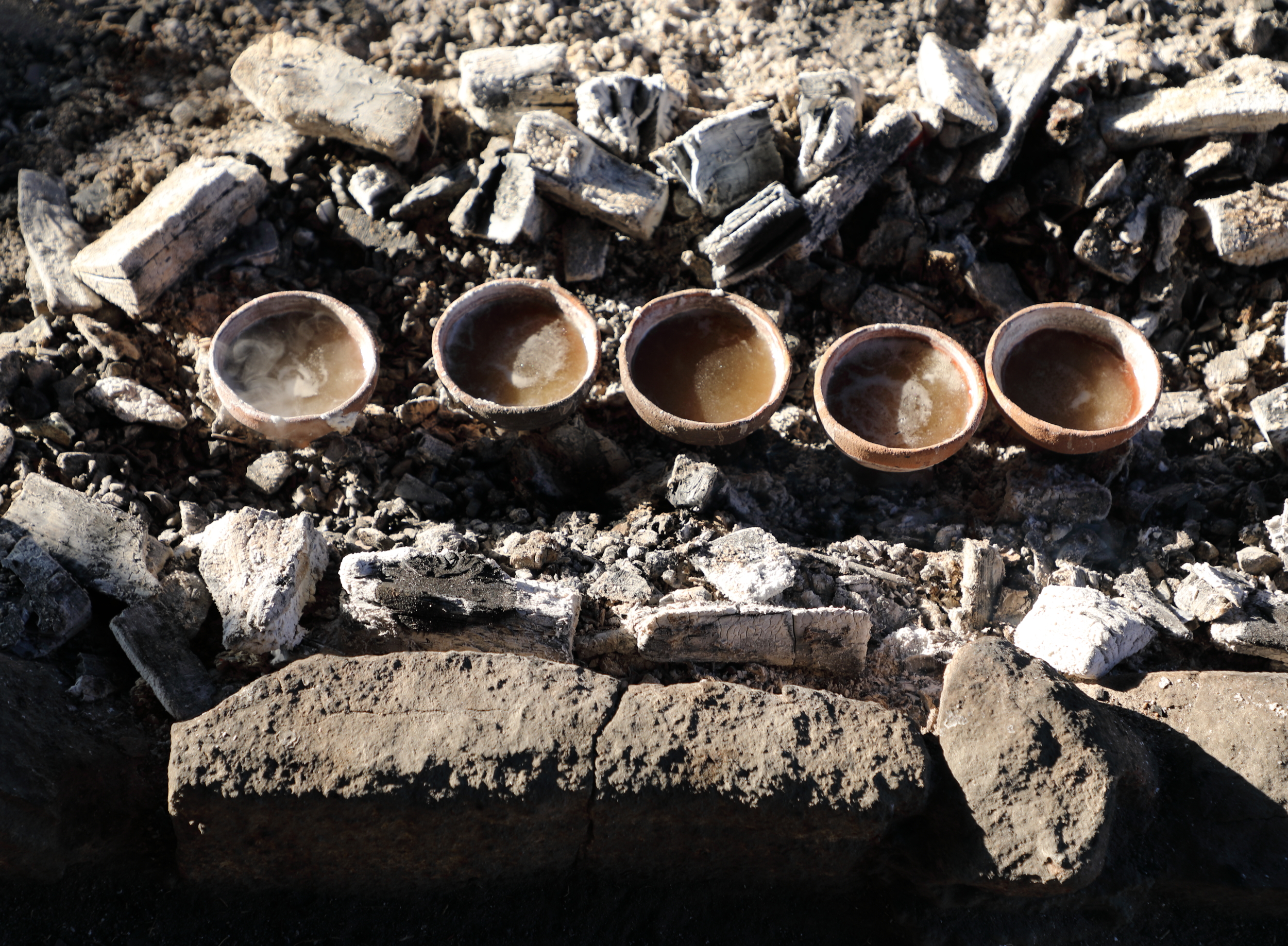 Recreation of ancient moshio salt making on a beach at Kami-kamagari Island in Japan's Seto Island Sea based on artifacts and ruins found nearby.