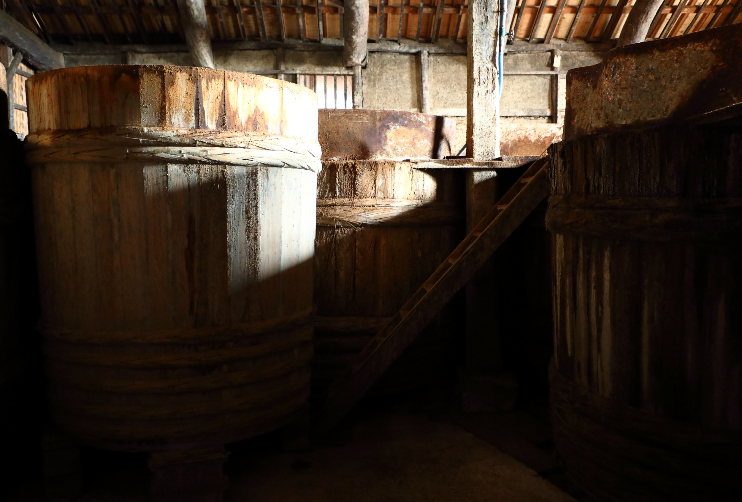 The  kioke  at Yamaroku are 2 meters high and 2 meters and 30 centimeters wide and hold 5,700 liters of  moromi , the fermenting mash of soy beans, wheat, sea salt, and water. Some of the  kioke  are more than seventy-five years old.