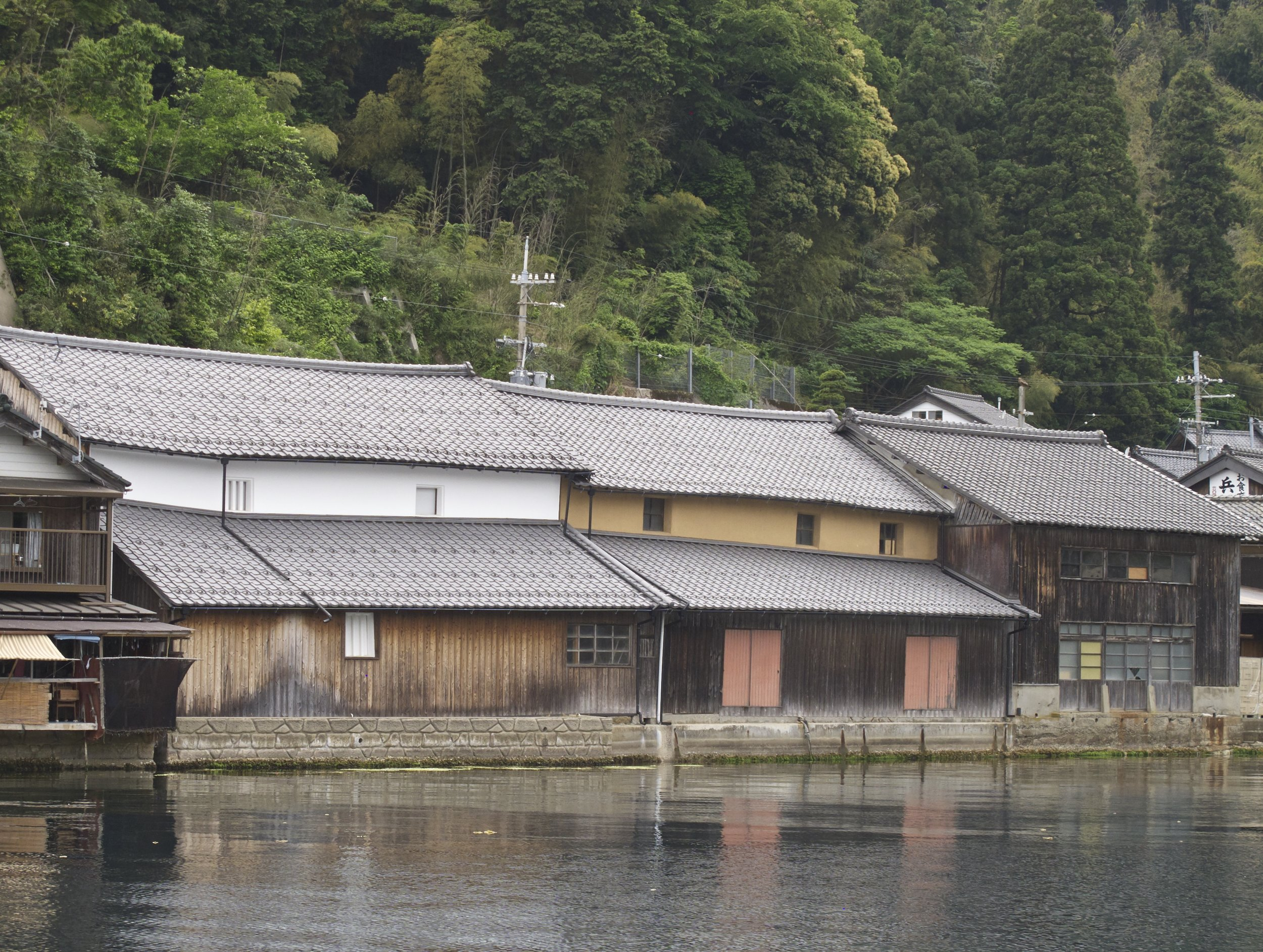 All buildings in Ine are edged along the bay, including the Mukai Shuzo Sake Brewery pictured here. Founded in 1754, the brewery is famous because its master brewer Kuniko Mukai is a woman and also because she makes a unique rose-colored sake called Ine Mankai, which has a sweet-acidic flavor that goes perfectly with the rich seafood caught in the bay.