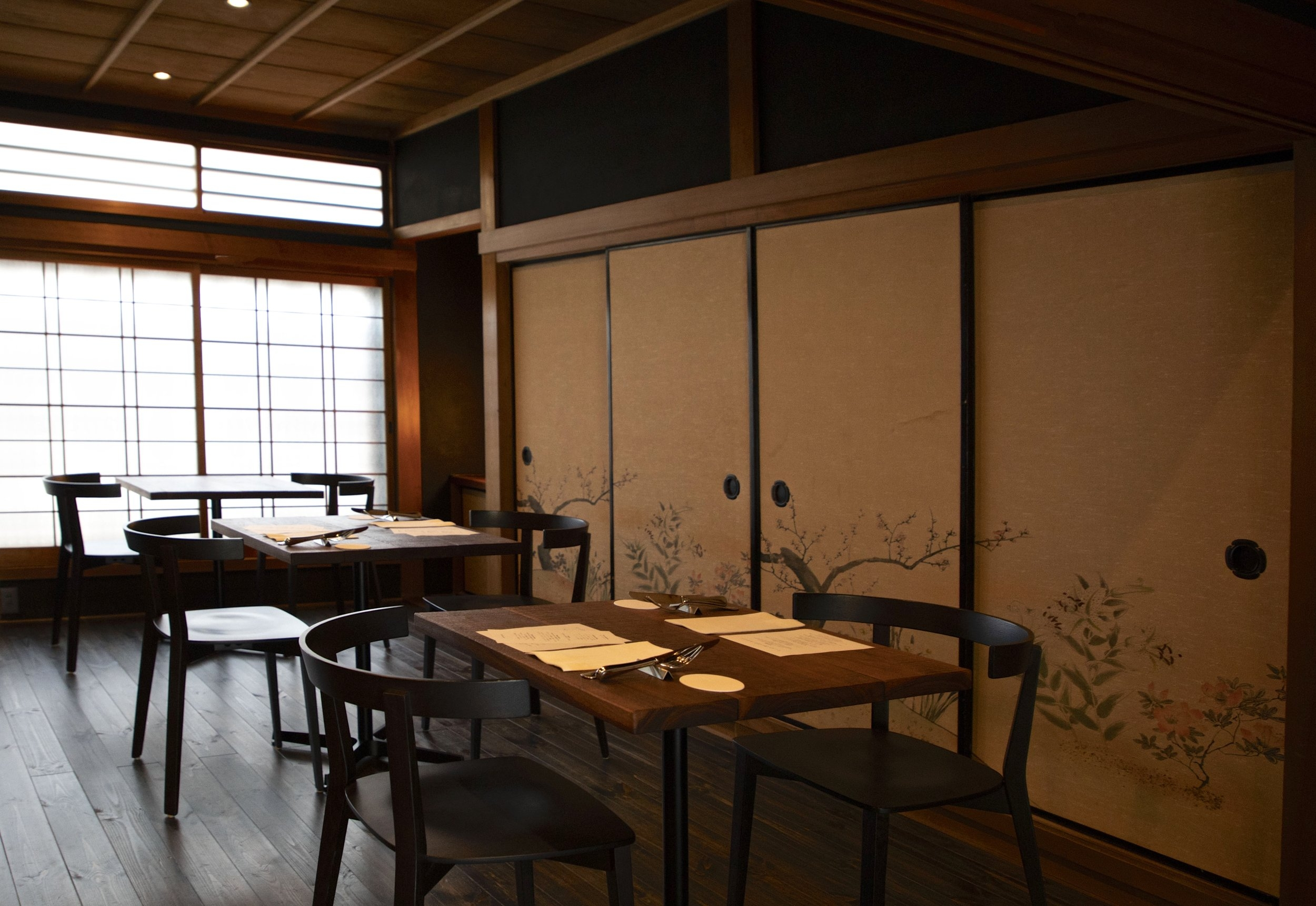 The renovation of the 120 year-old  ochaya  (geisha tea house), in which Aceto is located, preserved much of the building's old details, including the painted sliding doors in the dining room.