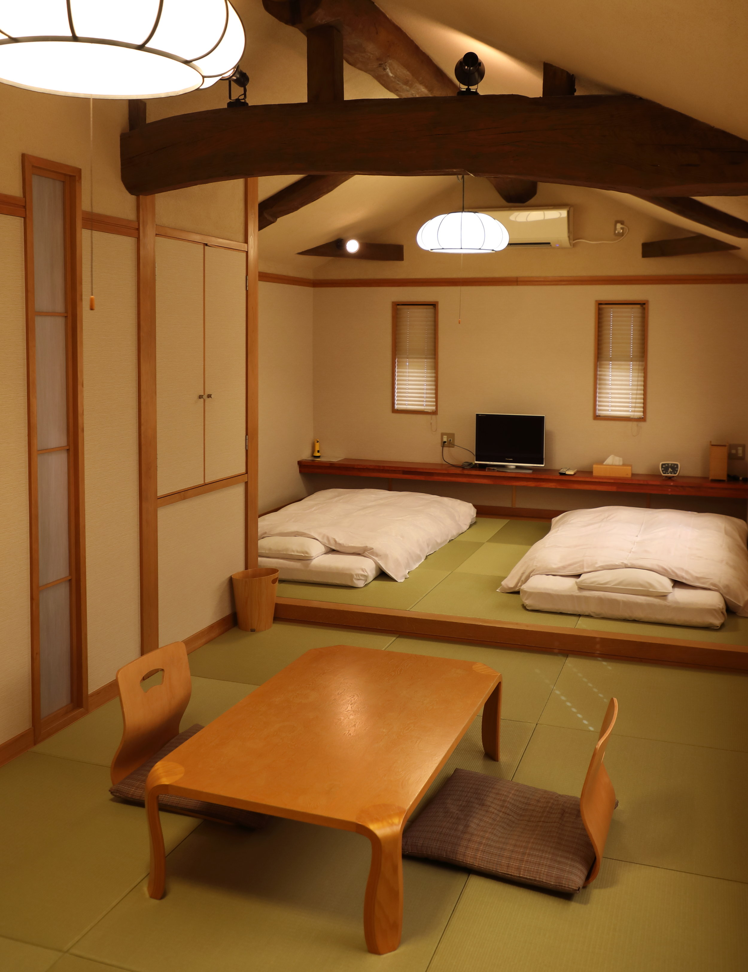 The large room upstairs in back at Kagiya can sleep up to four people. Depending on the size of your group, you can keep this as the bedroom and use the other room in front as your lounge.