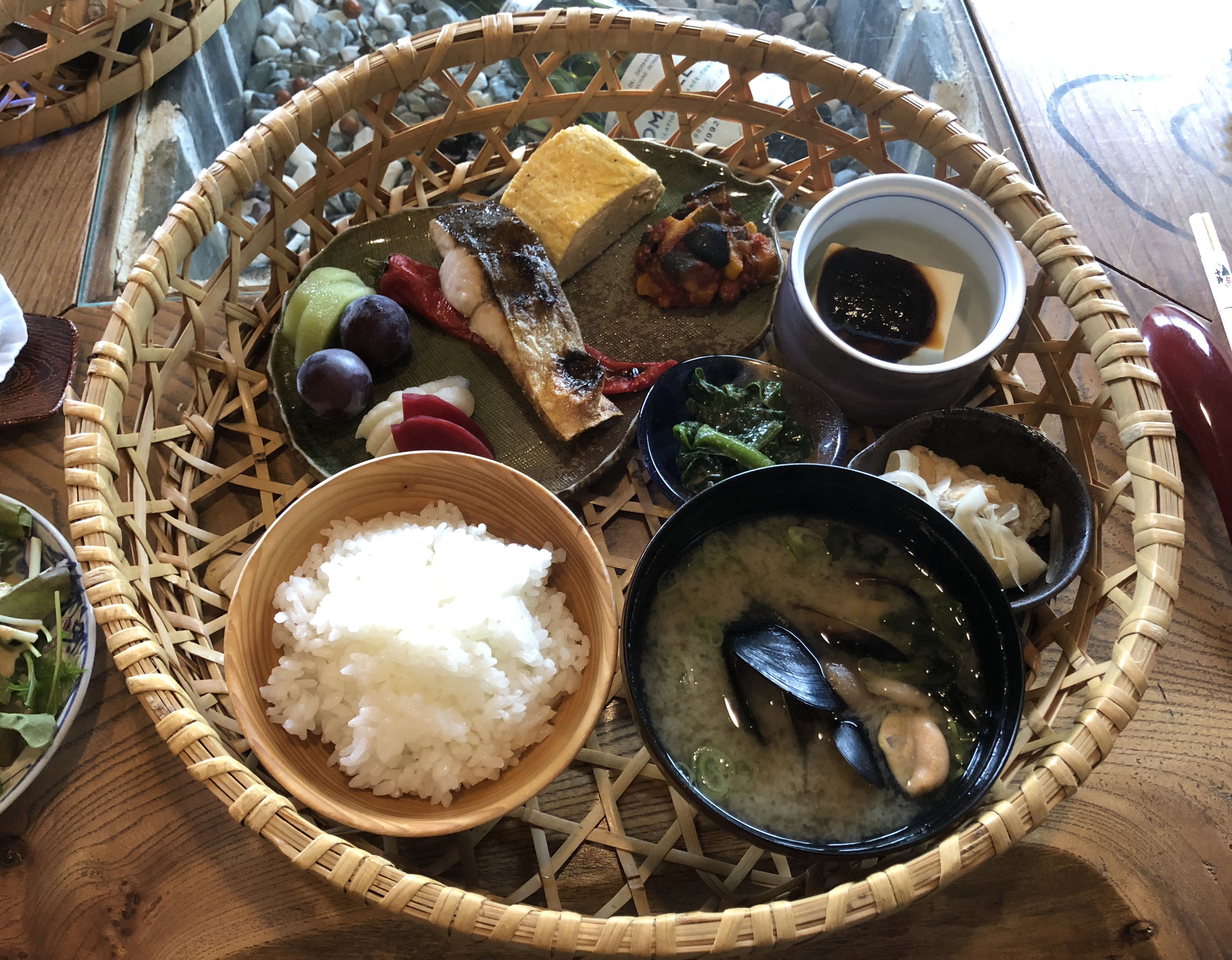 Breakfast another morning was served in a  makunouchi  bento box and included white rice and red miso soup with mussels.