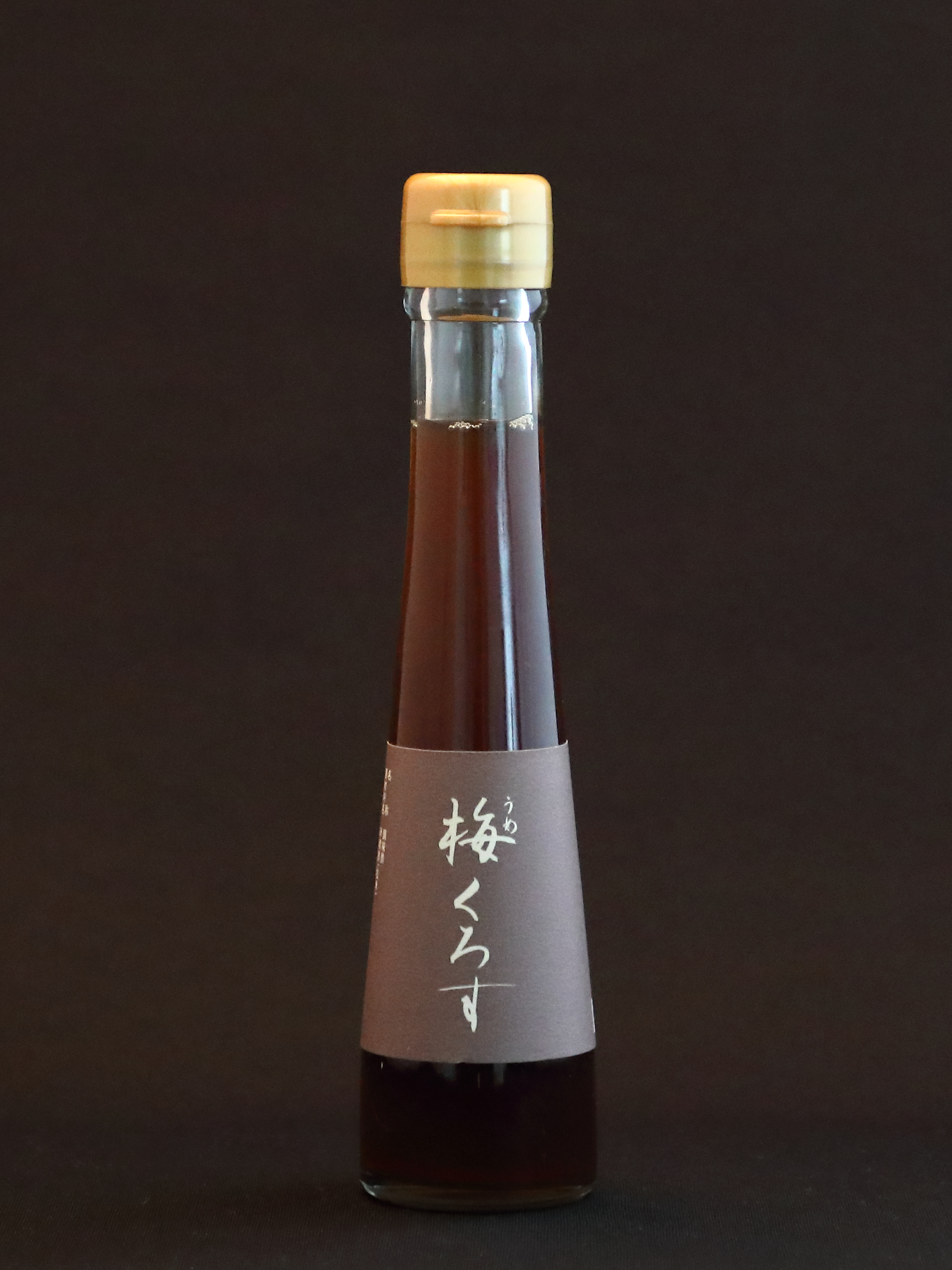Umesu (Sour Plum Vinegar) - Made from Iio Jozo's brown rice vinegar (genmai kurosu), sour ume plums, and raw sugar, this vinegar tames the extreme sourness of Japanese ume plums and gives their flavor depth and richness. It can be used in classical Japanese sunomono dishes and, like Iio Jozo's sweet potato vinegar, should be experimented with in drinks, dressings, vegetable dishes, fruit salads, and desserts. Also use it to brighten pork and game meat dishes.
