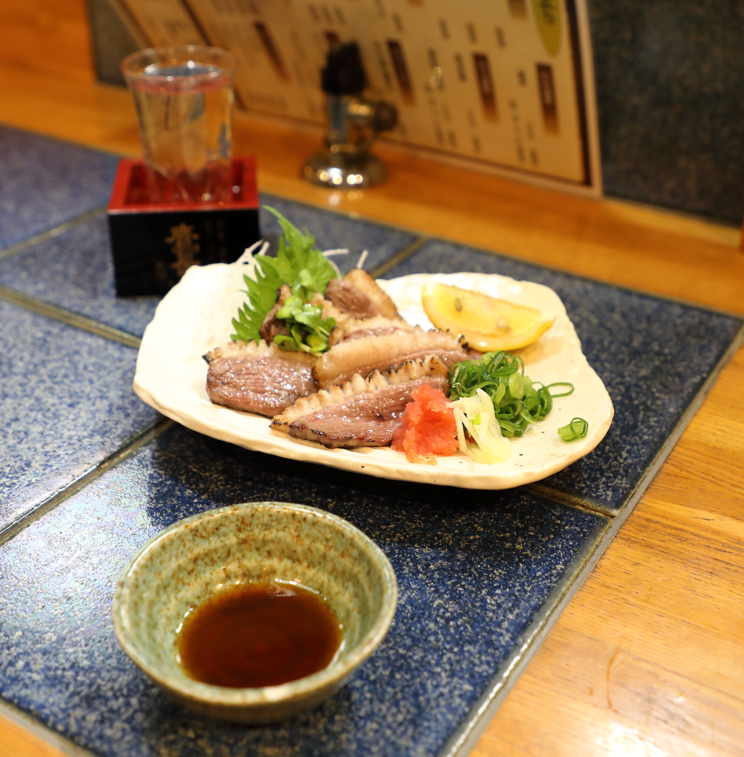 Sake was spritzed on the slices of duck breast before grilling them over a flame to help them brown. It was also used in the dipping sauce which is equal parts sake, soy sauce, and mirin. The sake served with the duck is a highly acidic one, typical of the artisanal types made in Nara prefecture, to best accompany the rich, gamey meats eaten in that mountainous, land-locked region of Japan.