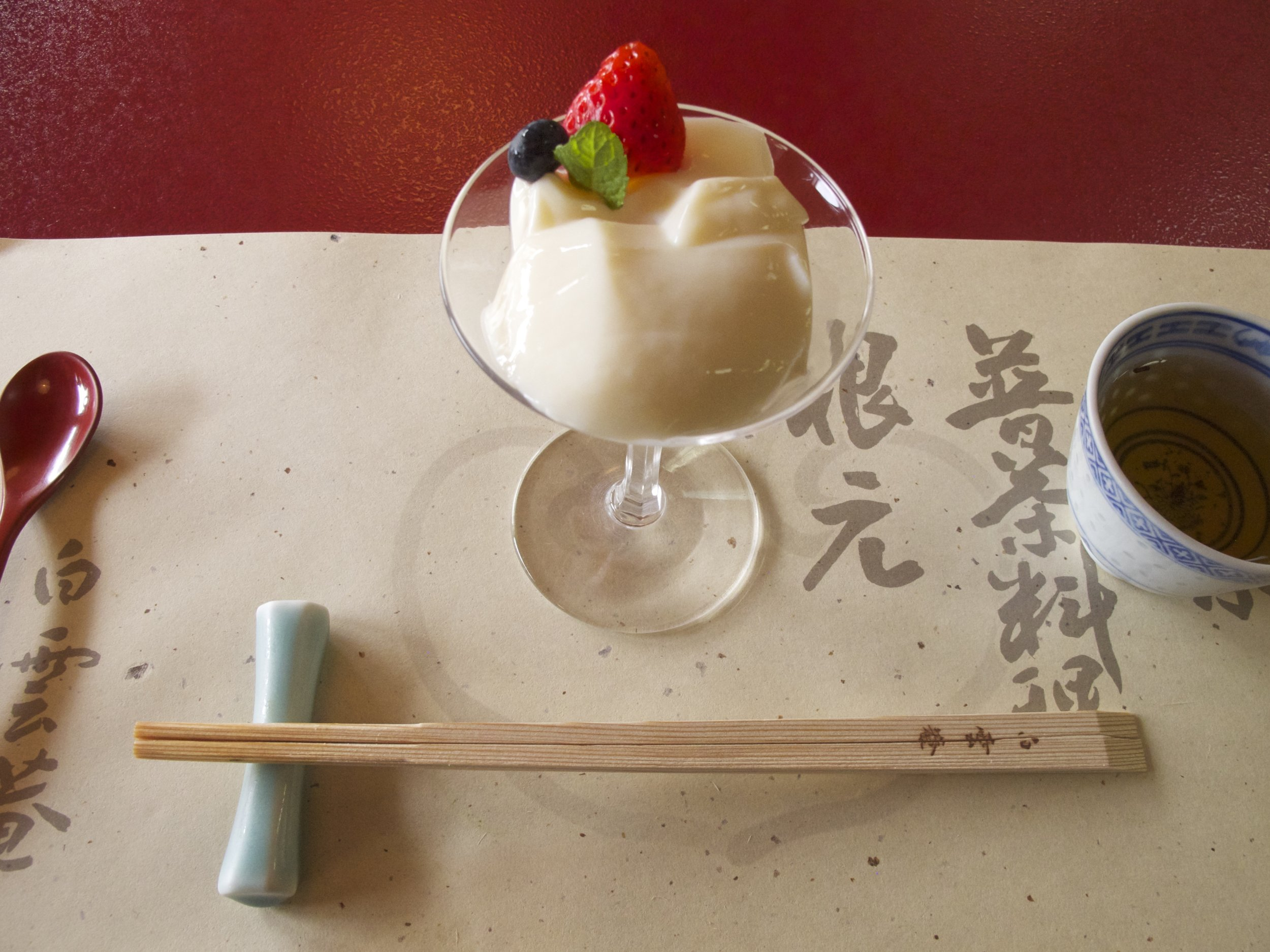 Dessert is a traditional Chinese pudding made from apricot kernel milk, sugar, and gelatin, called  annin-dofu  in Japanese.