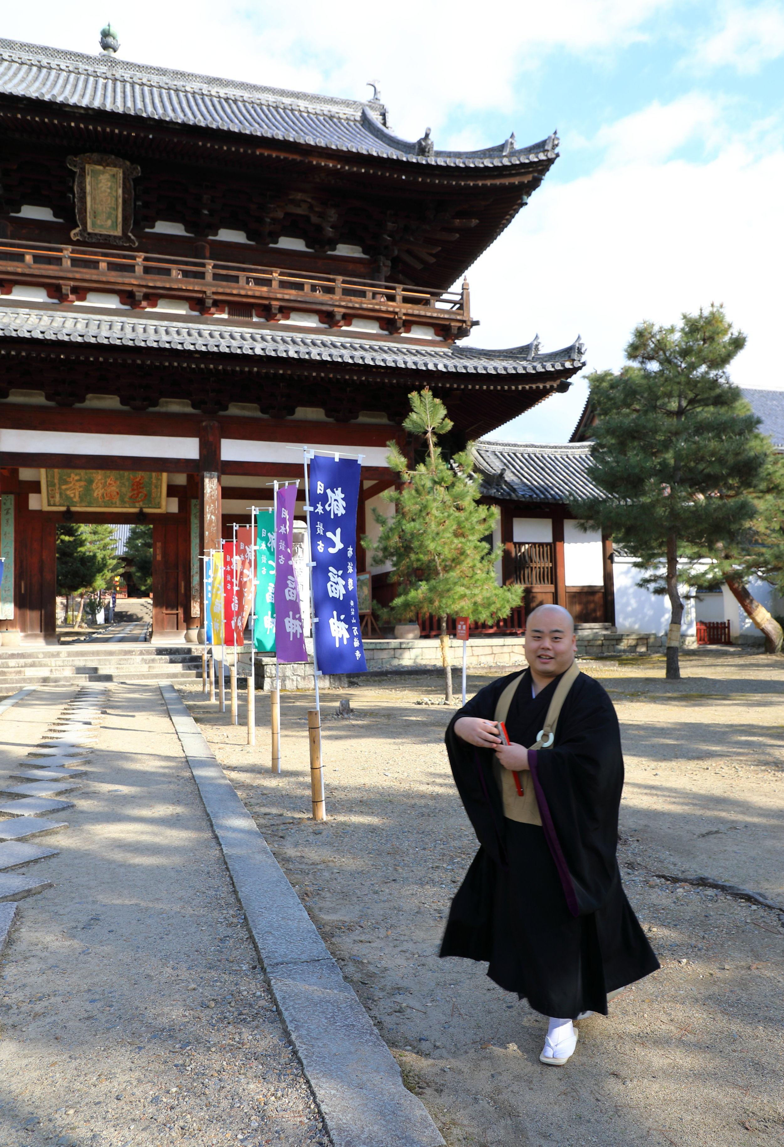 An Obaku Buddhist monk in front of the Sanmon Gate, the second and spiritually important gateway into the temple complex.
