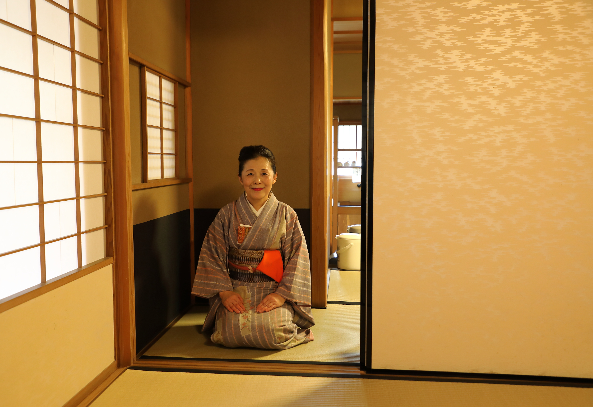 A  chanoyu  tea instructor entering the tea room at Taiho-an.