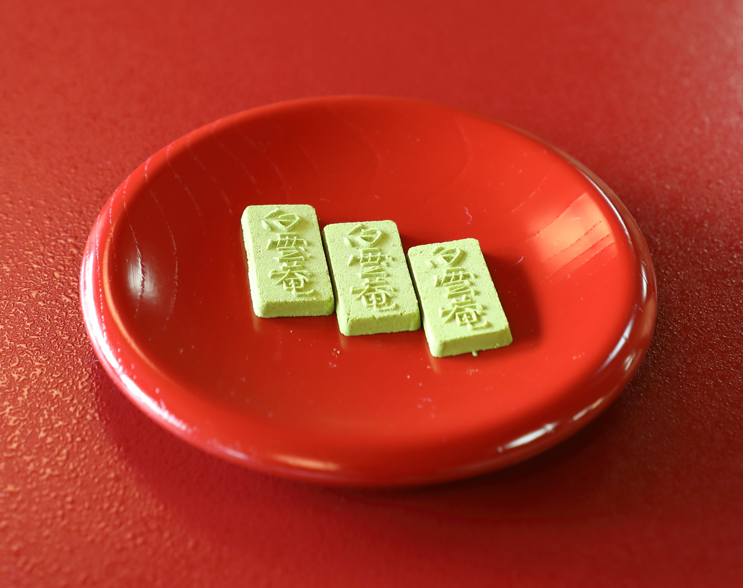 A welcome sweet made of powdered  matcha  green tea and traditional  wasanbon  sugar.