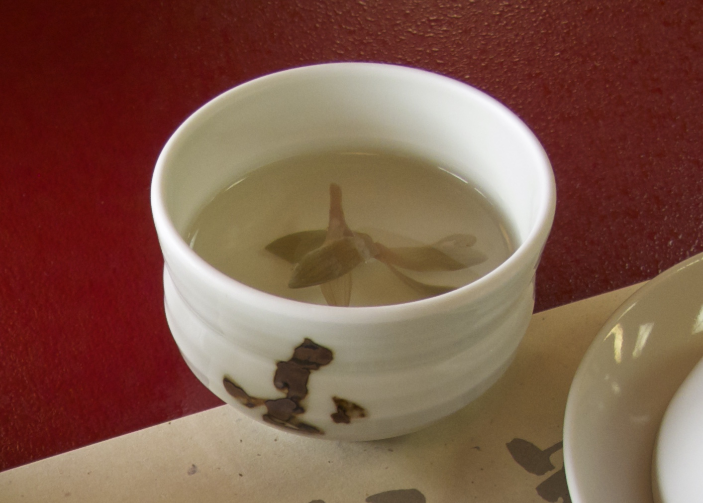 "The first of two soups is a clear light broth containing a single preserved orchid; a flower which symbolizes ""awakening"" for Buddhists."