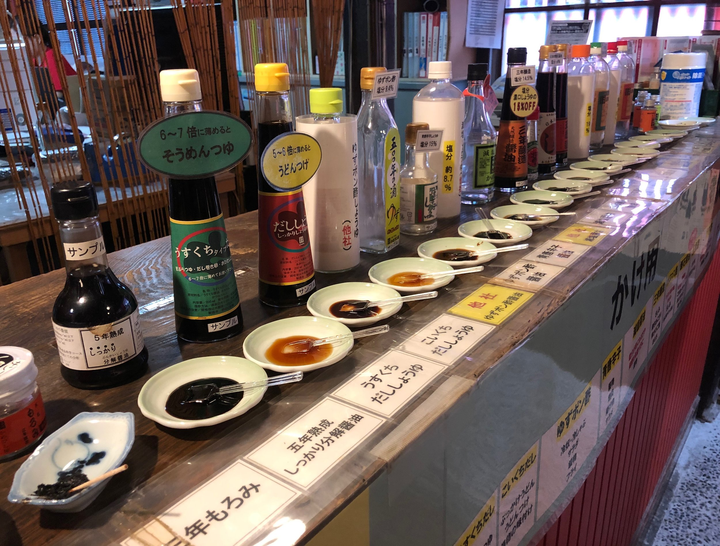 The array of soy sauce products available for tasting in the shop at Kamebishiya.