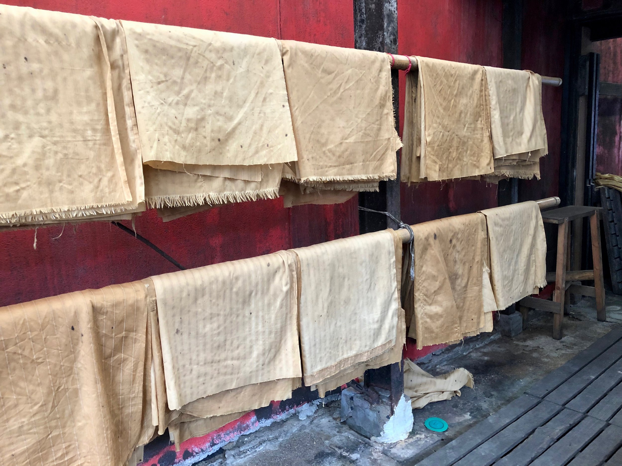 The cloth bags in which the  moromi  mash is pressed hanging out to dry.