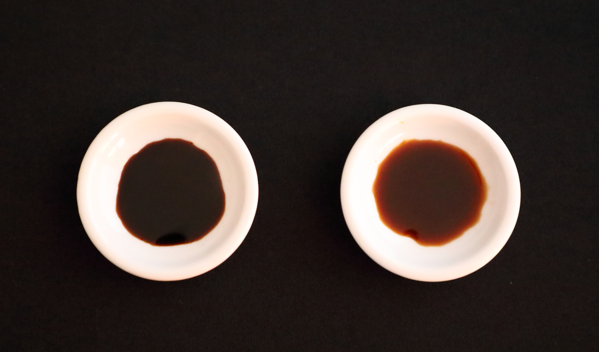 On the right, Kamebishiya's  koikuchi  soy sauce has the red color characteristic of high-quality, artisanally-made soy sauce. Its three-year soy sauce on the left is much darker in color reflecting its deeper, richer flavor.