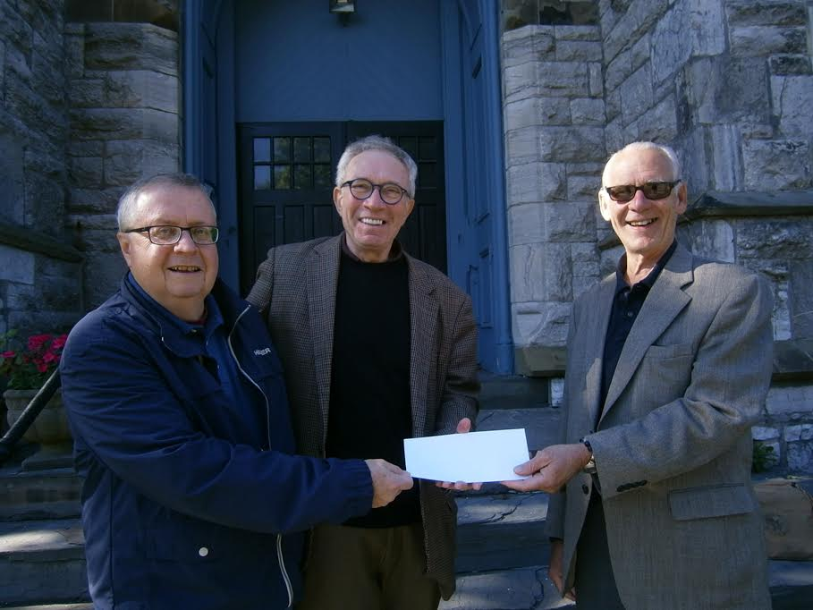 The Hudson River Bank Foundation has awarded $10,000 to the Friends of the First Presbyterian Church of Hudson. Shown here from left: Church project coordinator John Grover, Phil Forman, head of the Friends, and representing HRBT, Tony Jones. The funding will be used to cover stabilization and reinforcement of existing roof trusses – found to have been compromised after 200 years of continuous load bearing. This work is being done in advance of more extensive construction that will permanently repair the roof
