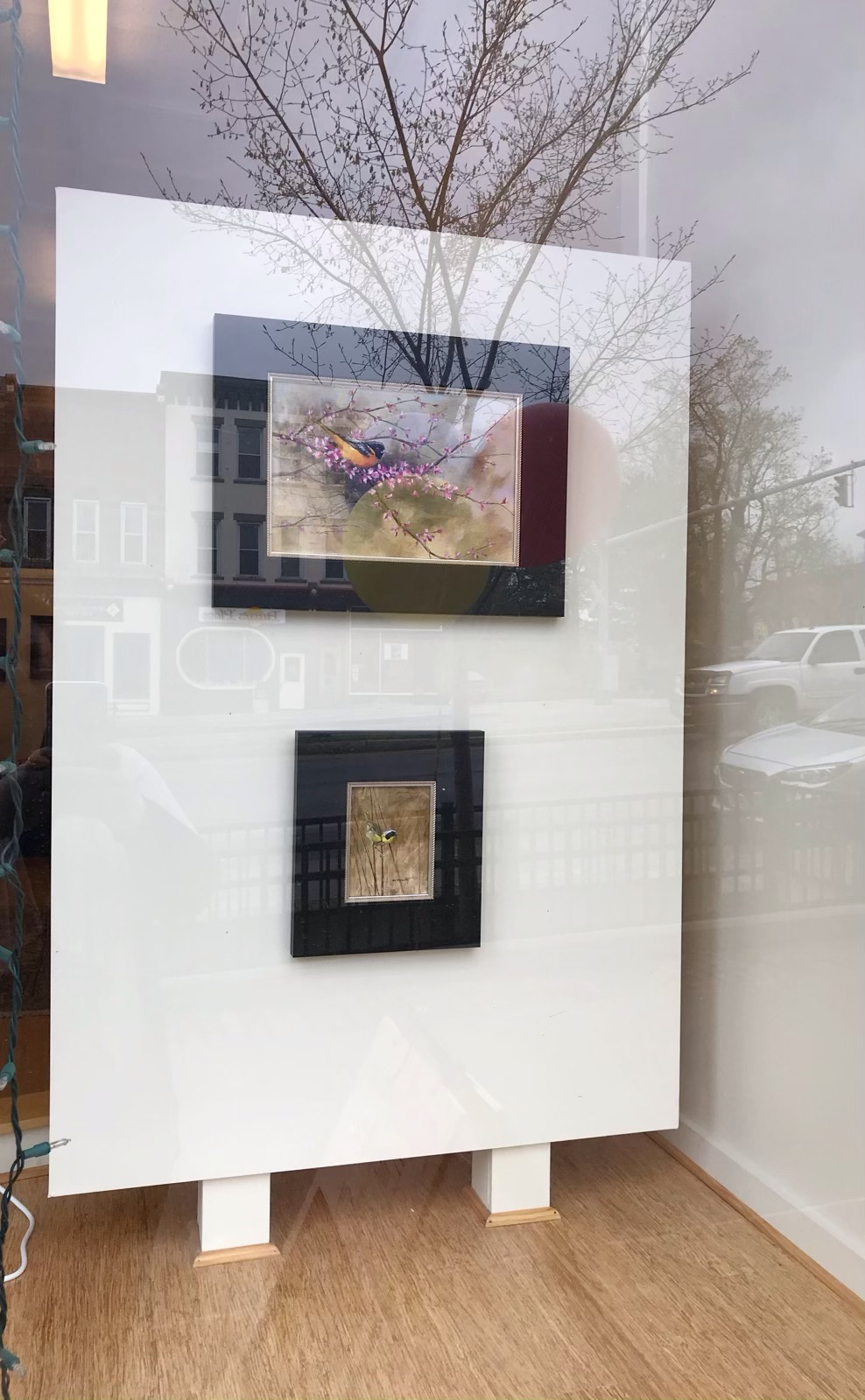 Nancy's two paintings in the front window of the gallery.