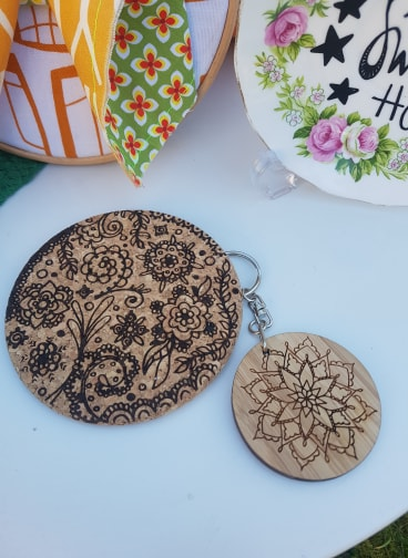 Laser cut coasters and keyrings in a variety of styles by Bec Ashford, from £4.99