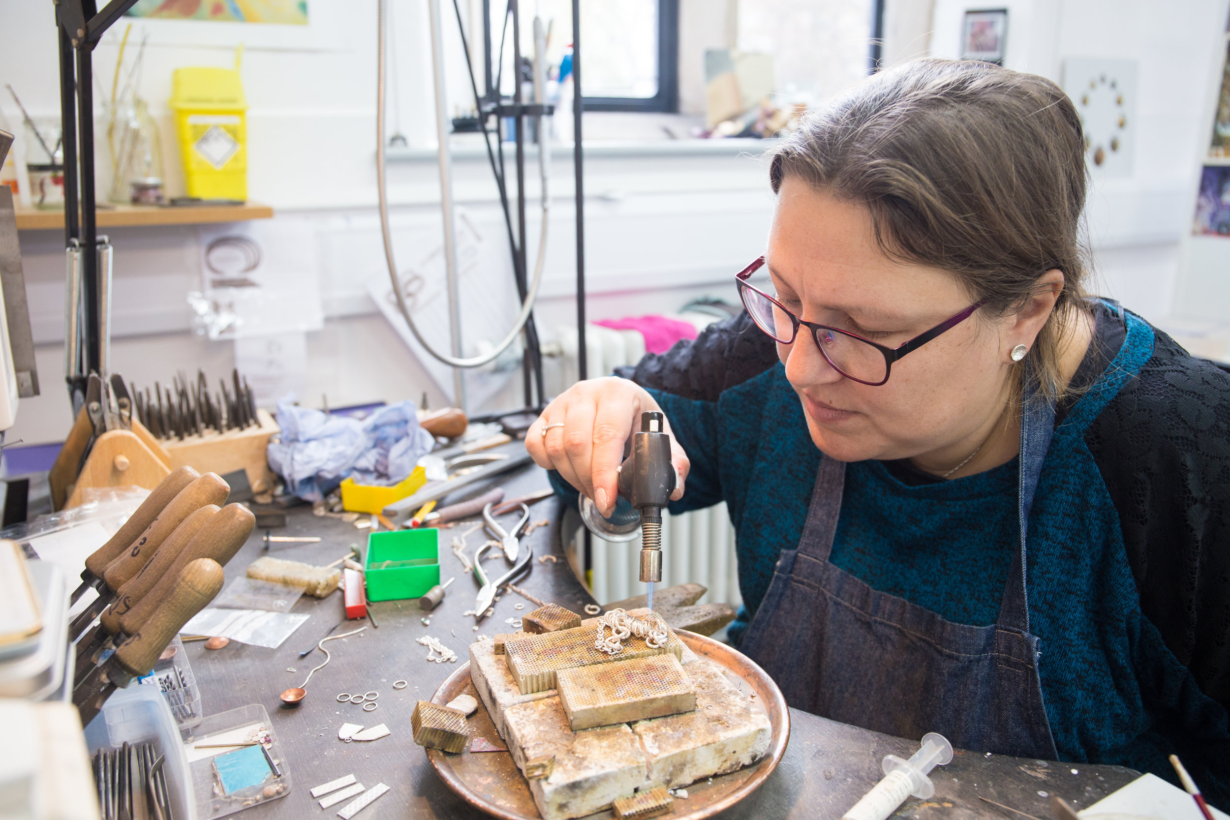 Sarah Pasley, Silversmith & Jeweller - SARAH IS A JEWELLER BY DAY AND AN AWARD WINNING SILVERSMITH IN HER SPARE TIME. SHE CRAFTS COMMERCIALLY FOCUSED JEWELLERY INSPIRED BY THE RESEARCH AND SKILLS SHE DEVELOPED WHILST DESIGNING AND MAKING HER LARGE METAL WORKS.