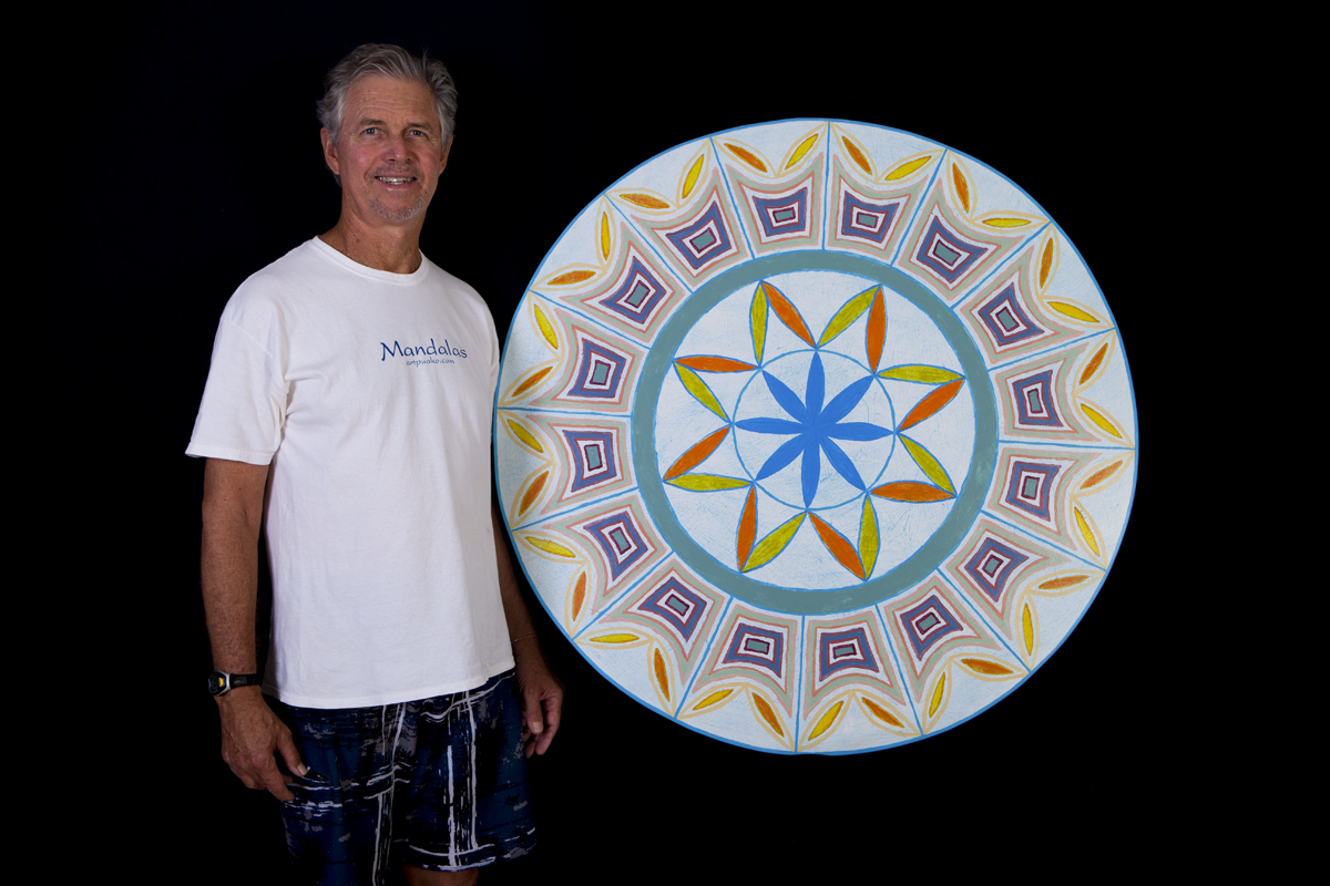 "Artist Frank Snow with his 44"" mandala ""Eternal Delight""."