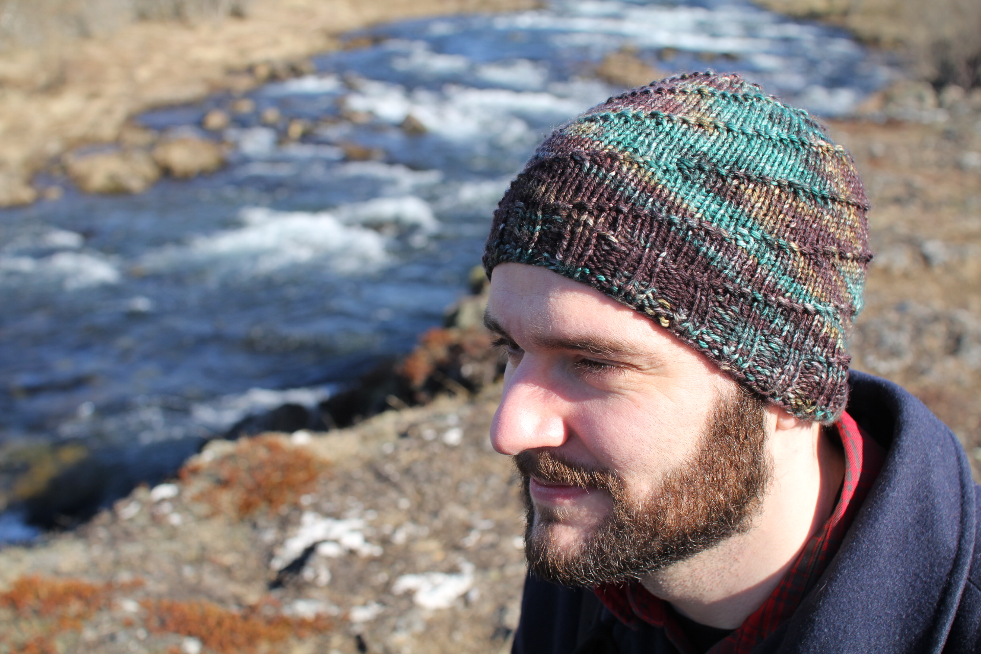My husband wearing his first hat which he knitted and dyed the yarn for!