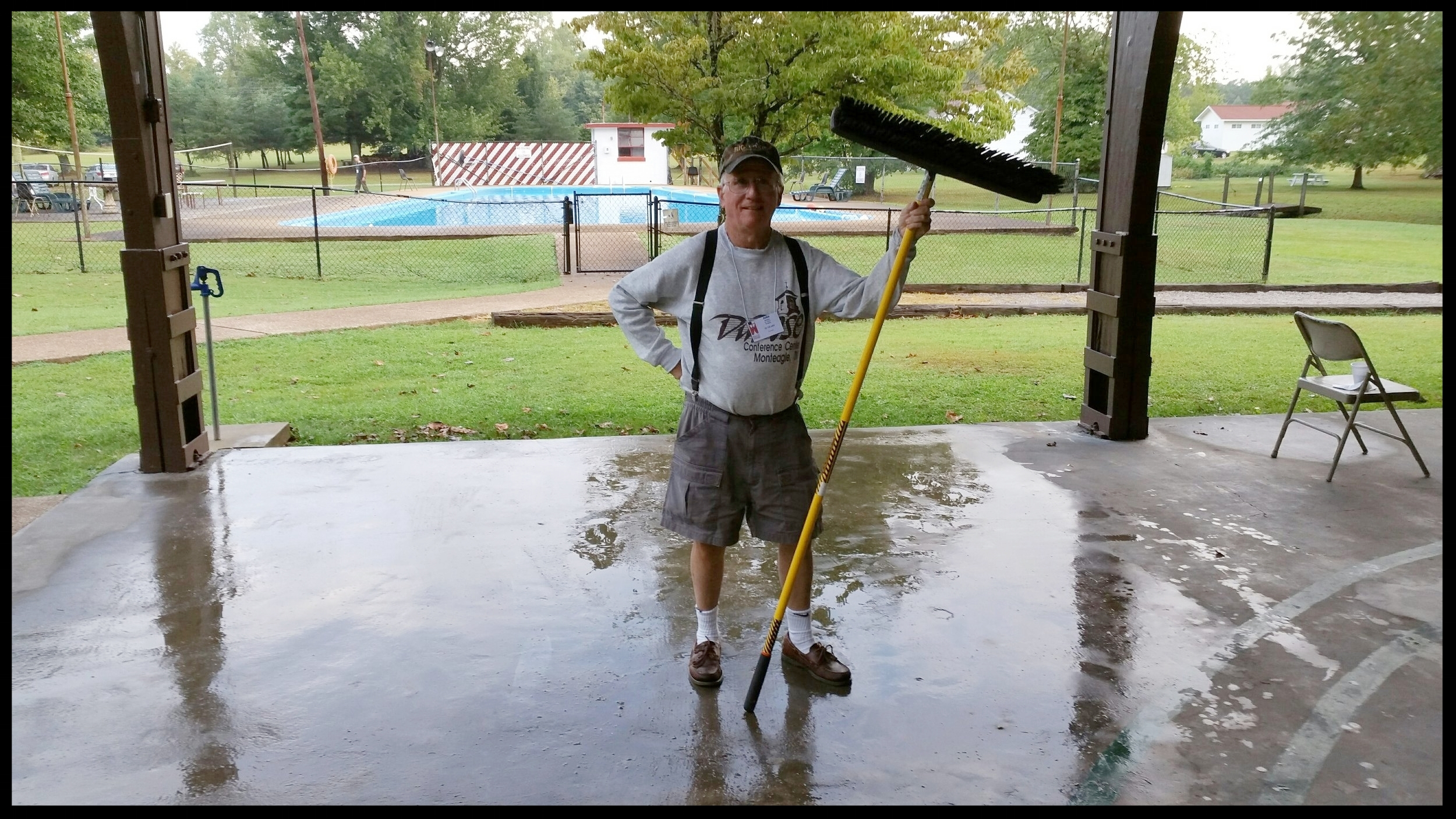volunteer john barbee helps to clean off the pavilion during the annual ect laymen's conference.