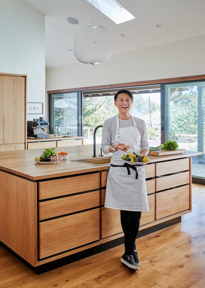 Chef Melissa King test-drives the new kitchen (cabinets, Garde Hvalsoe; photo credit: James Carriere, courtesy of Staprans Design).