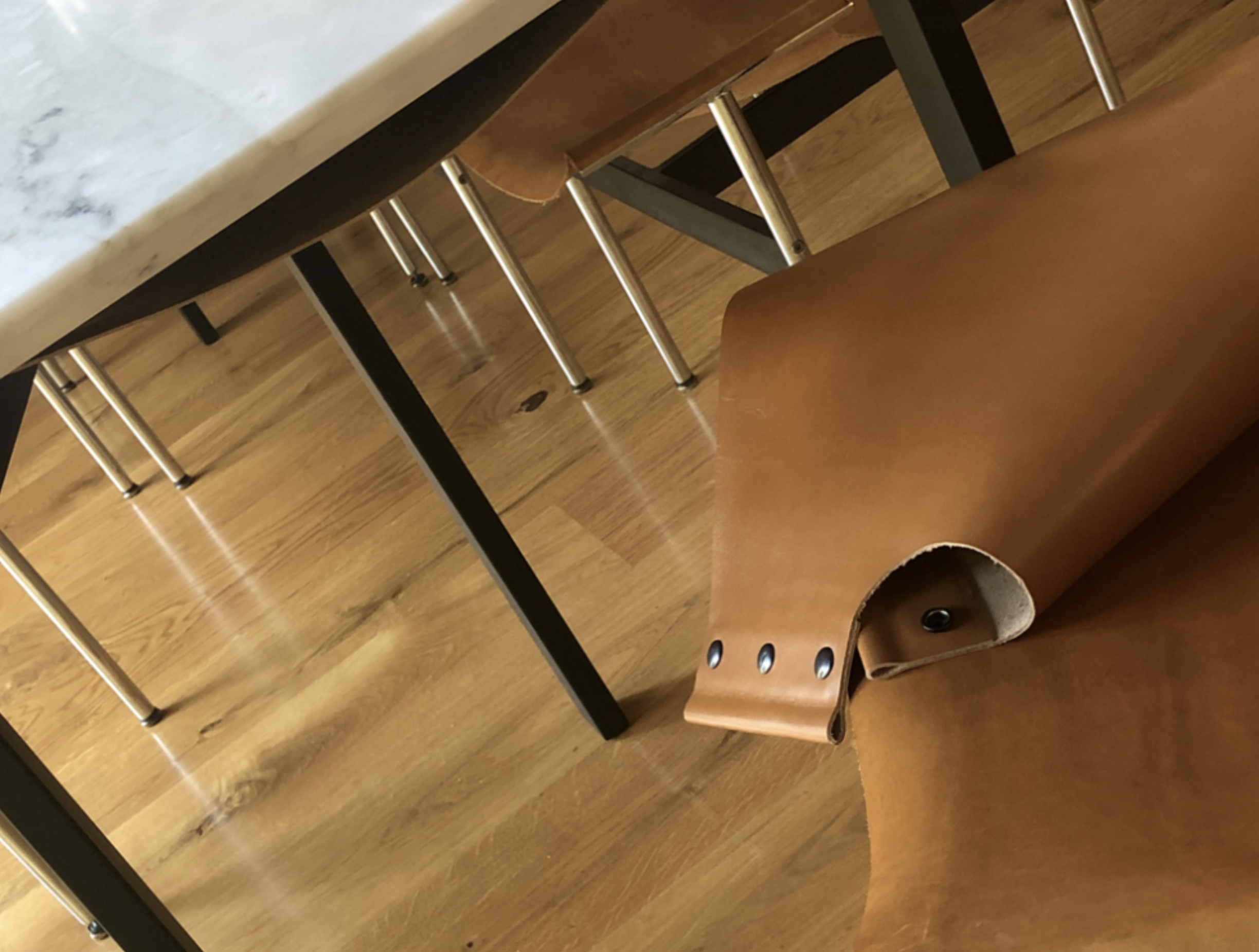 Yutian's leather shelves match the '50's chairs perfectly.