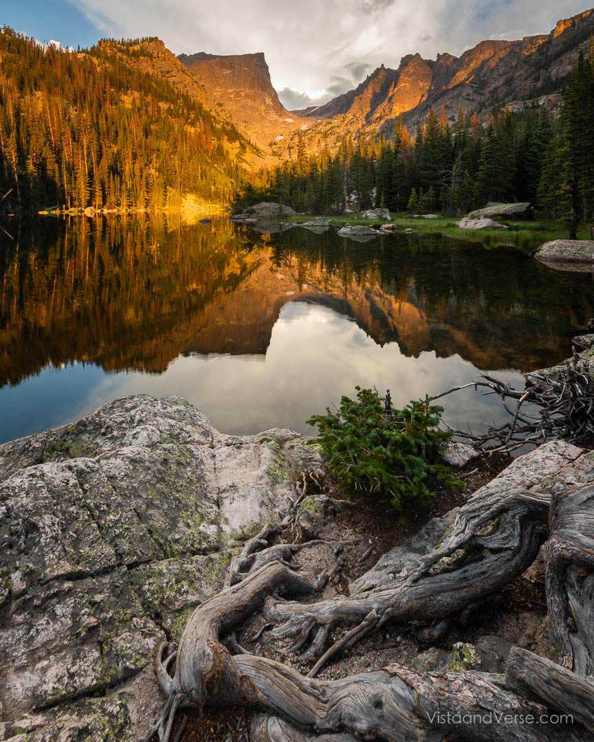 Dream Lake reflects the alpenglow of Hallet Peak in Rocky Mountain National Park