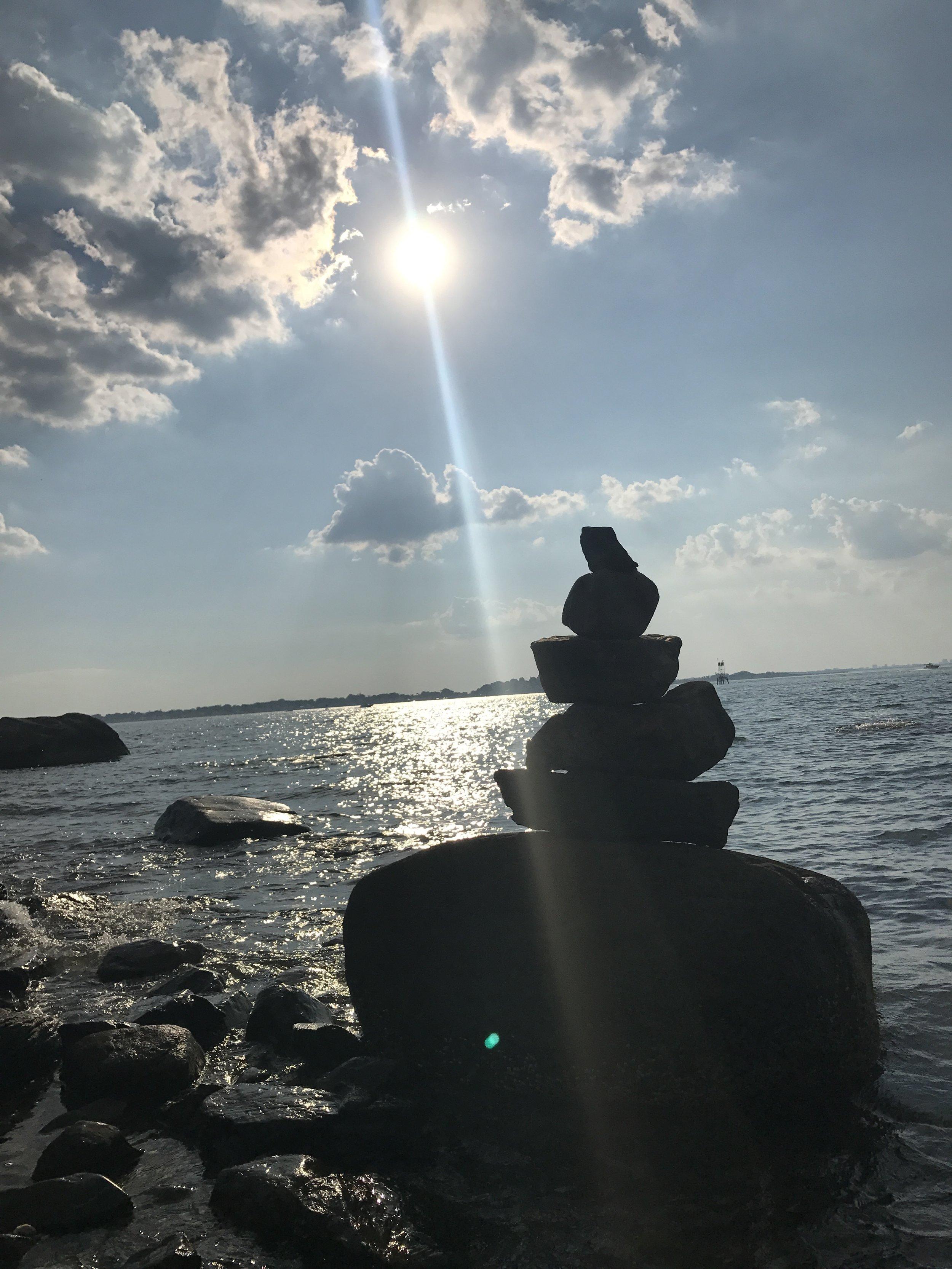 A cairn along the shoreline of Grape Island in Boston Harbor.