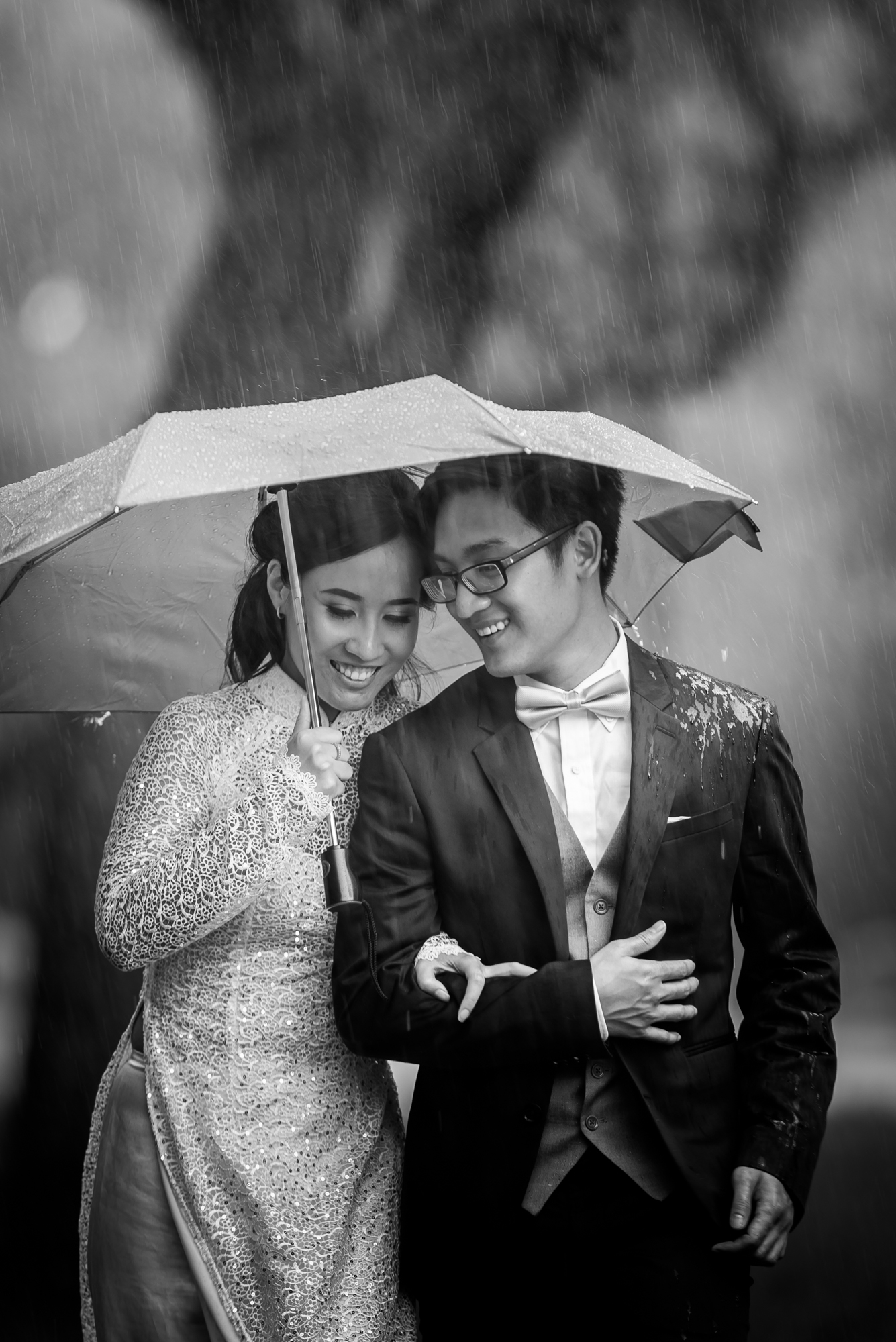 - The shoot ended with us running for cover from the rain.  As I put my gear down, I noticed an incredible moment when the couple was leisurely walking towards the shelter, all the while smiling.
