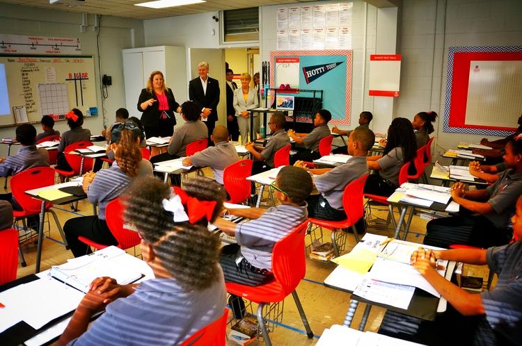 Above, MS Gov. Phil Bryant tours Reimagine Prep classrooms with Principal Christina McDonald.