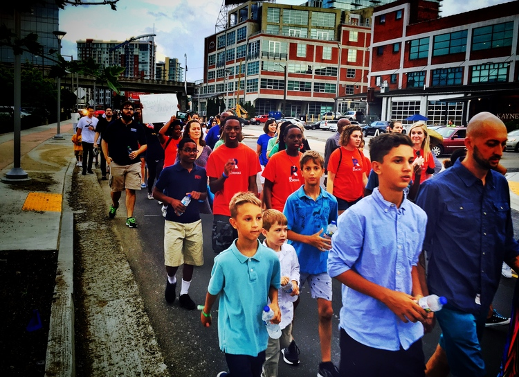 The crowd marched down 12th Avenue South and through the Gulch amidst the support and encouragement of onlookers.