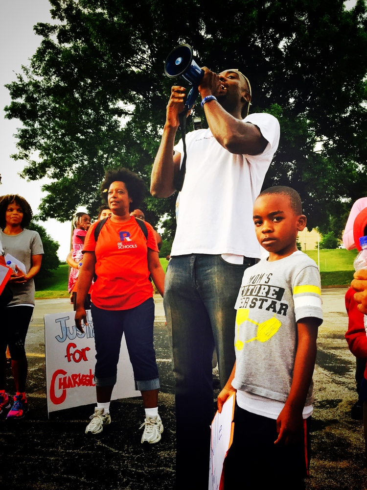 Nashville Classical parent John Little and his son address a crowd of supporters at the end of the march.