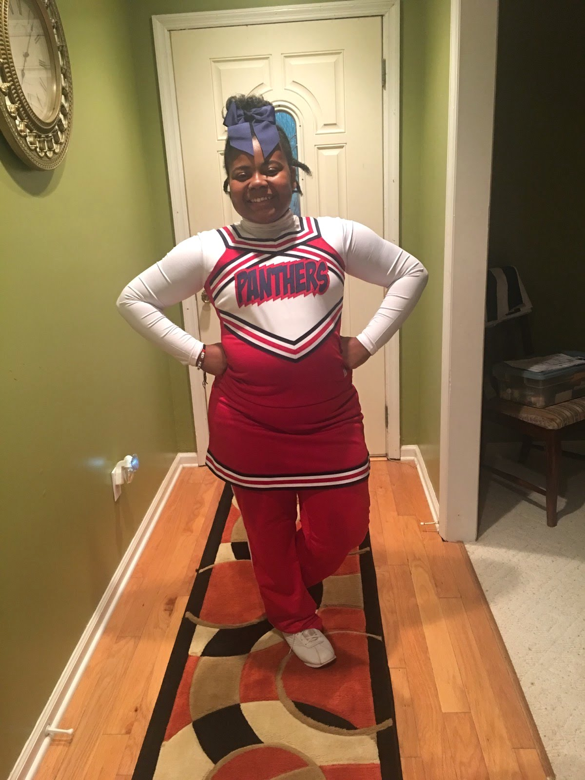 Janiya is ready to lead her team and school before a Nashville Prep football game.
