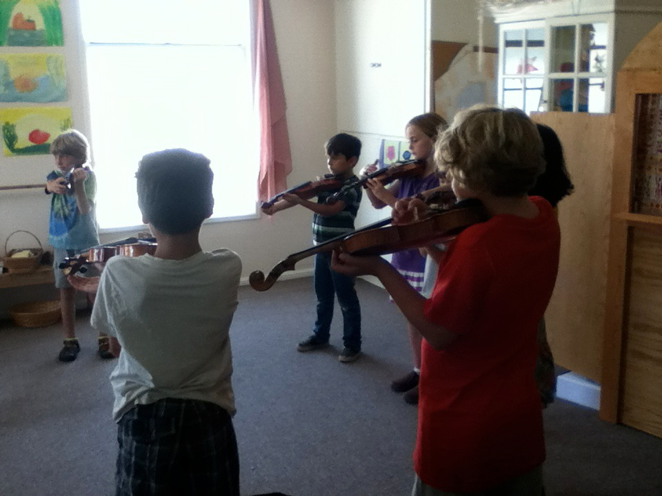 Children are also expected to learn traditional string and wind instruments as they mature musically.