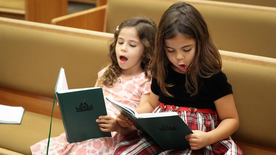 girls-singing-hymnals-resized.jpg