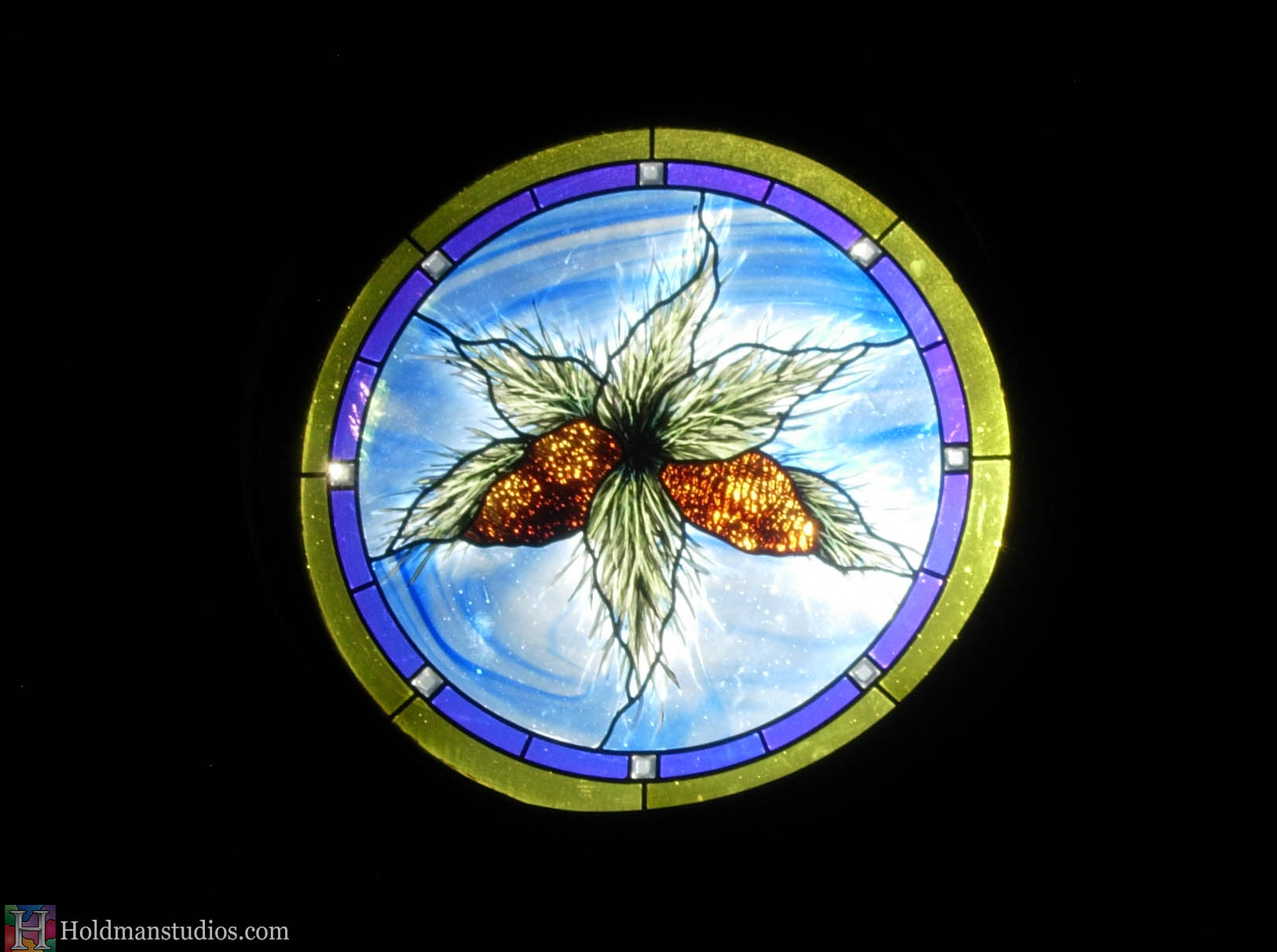 Stained glass round window of leaves Created by artists under the direction of Tom Holdman at Holdman Studios.