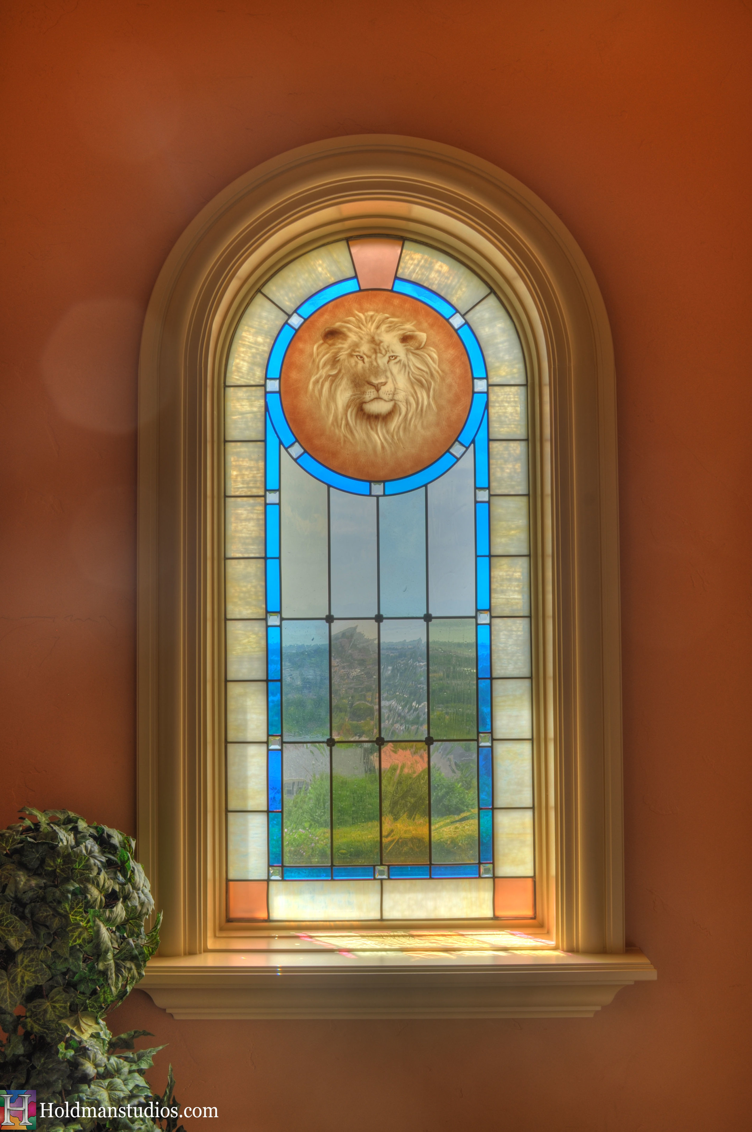 Stained glass lion window. Created by artists under the direction of Tom Holdman at Holdman Studios.