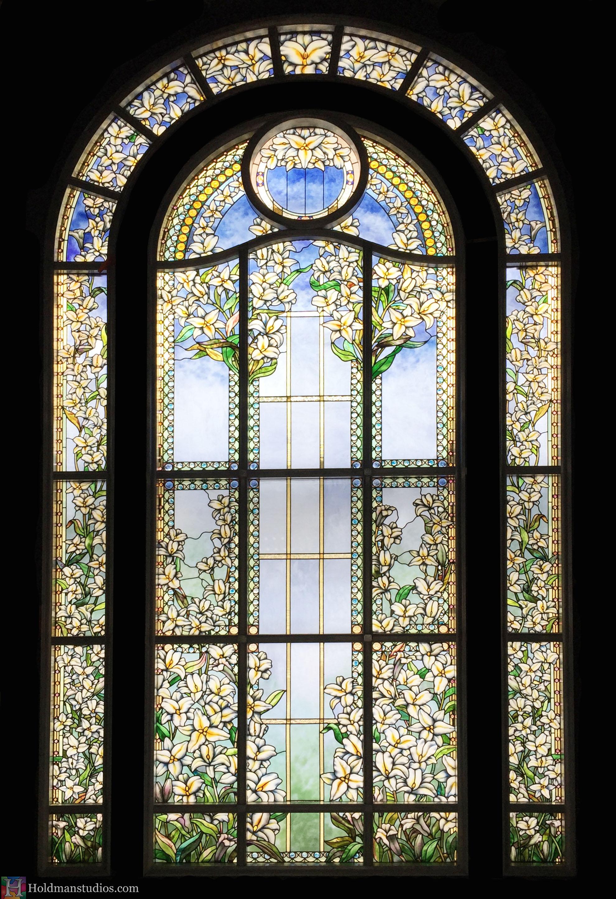 Holdman-Studios-Paris-LDS-Temple-Stained-Glass-Madonna-Lily-Flowers-Leaves-Sun-Moon-Stars-Full-Window.jpg
