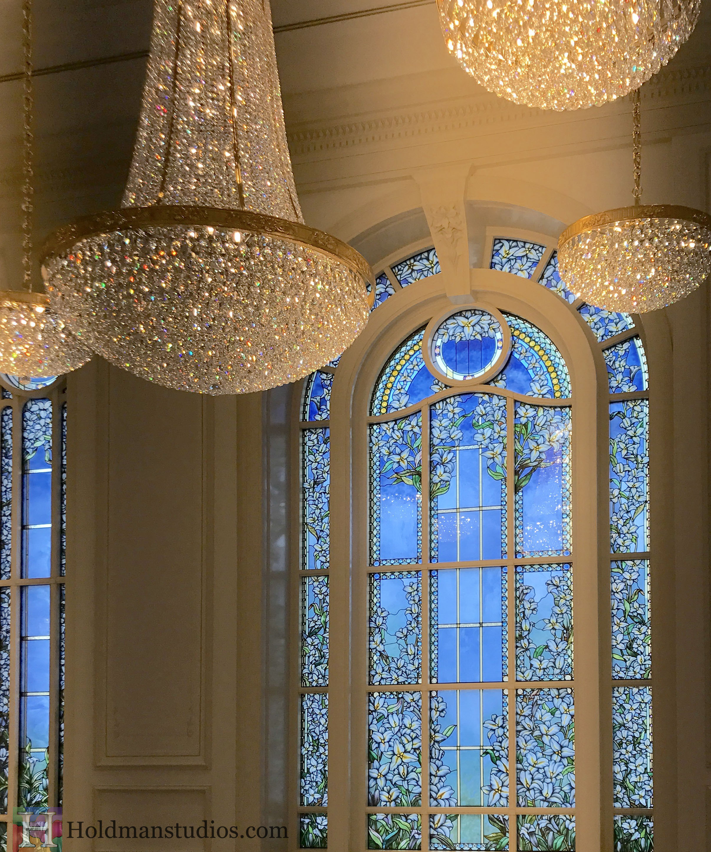 Holdman-Studios-Paris-LDS-Temple-Stained-Glass-Madonna-Lily-Flowers-Leaves-Sun-Moon-Stars-Windows-Chandeliers.jpg