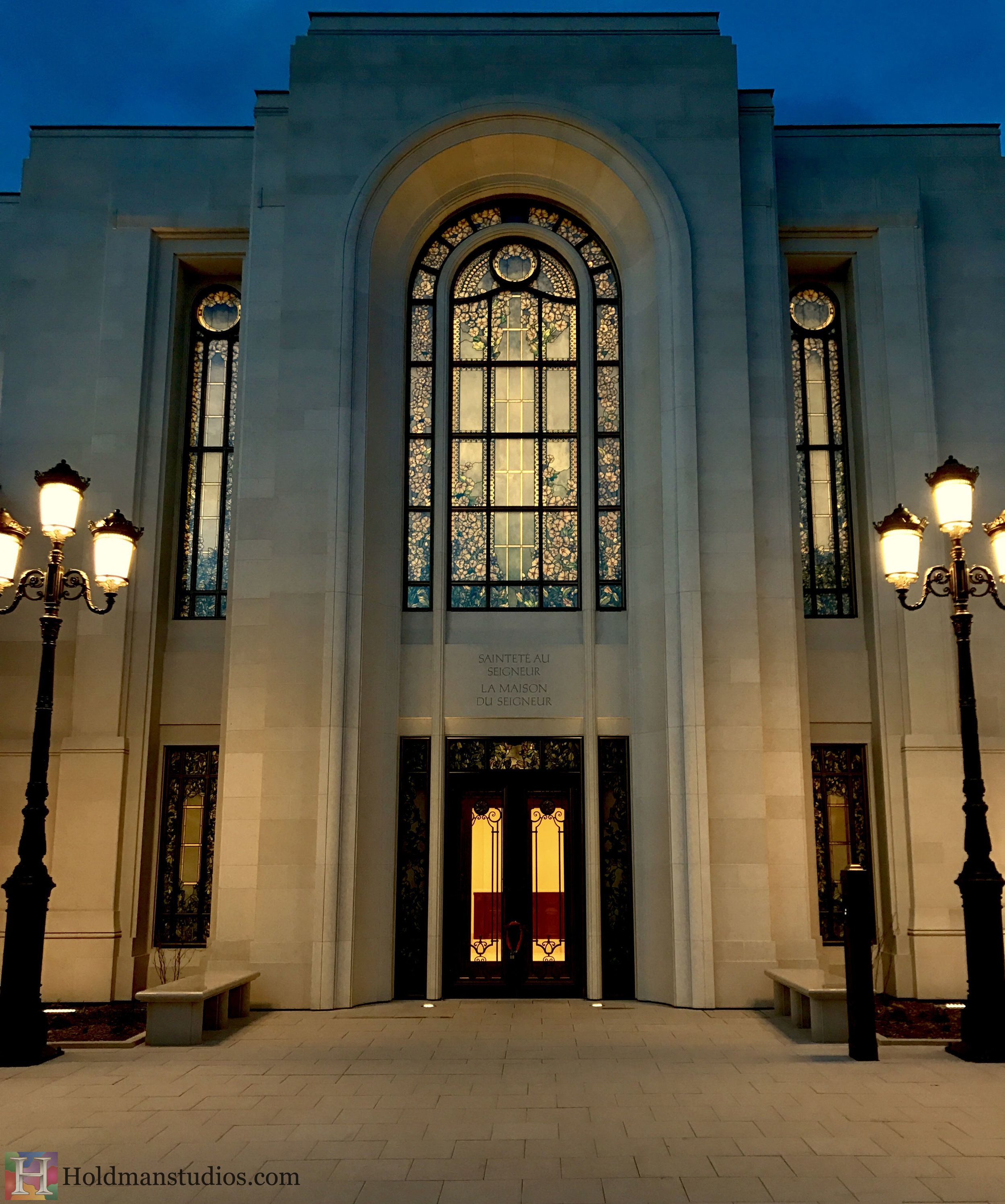 Holdman-Studios-Stained-Etched-Glass-Paris-LDS-Temple-Madonna-Lily-Flowers-Exterior-Entrance-Windows-Nightview.jpg