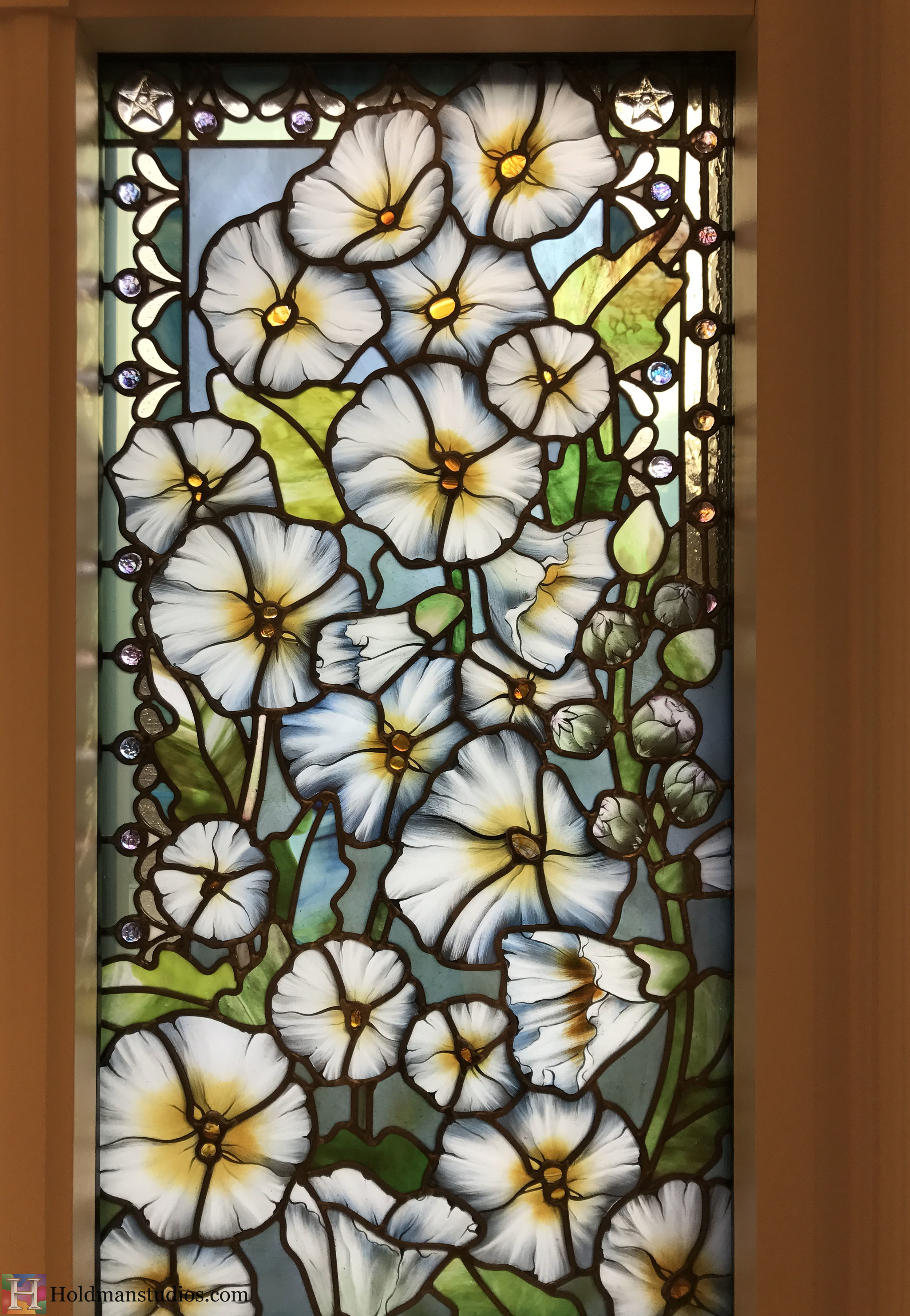 Holdman-Studios-Stained-Glass-Paris-LDS-Temple-Cornflower-Blue-Lily-Flowers-Buds-Leaves-Stars-Closeup-Windows.jpg