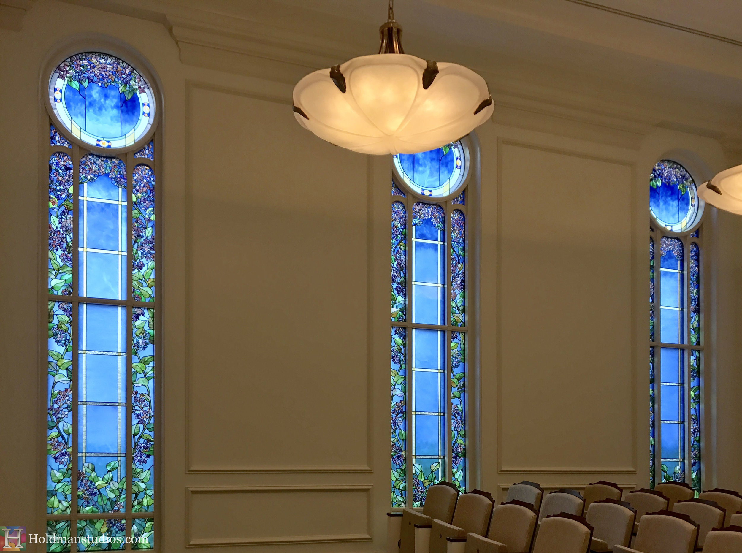 Holdman-Studios-Stained-Glass-Paris-LDS-Temple-Lilac-Flowers-Leaves-Round-Windows.jpg