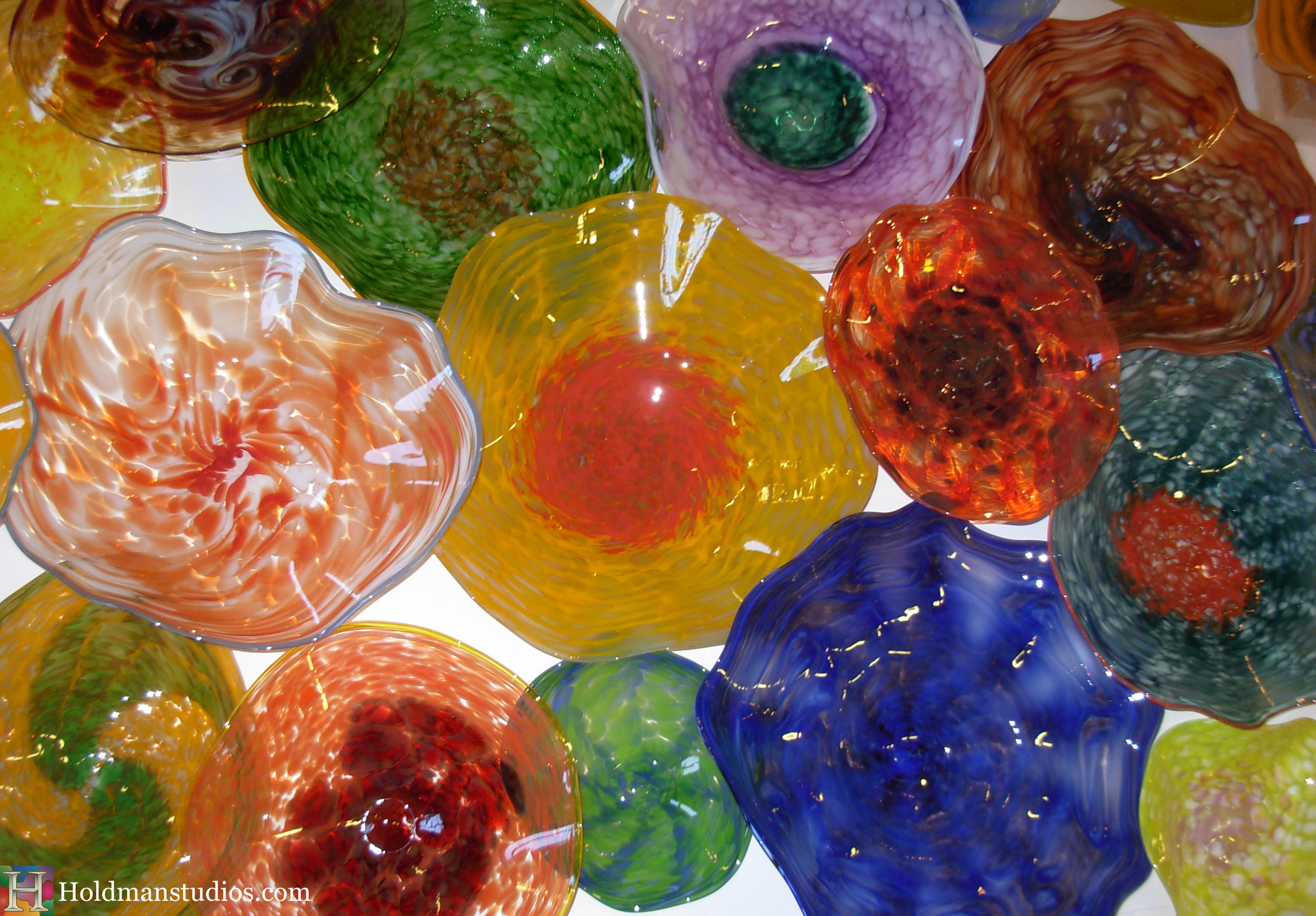 Hand blown platters. Created by artists under the direction of Tom Holdman at Holdman Studios.